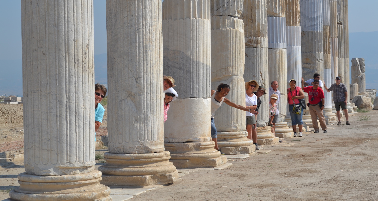 Members of our 2013 study tour to Turkey play hide and seek among the restored columns of Laodikea. Photo by Bible Land Explorer Adam Chambers.