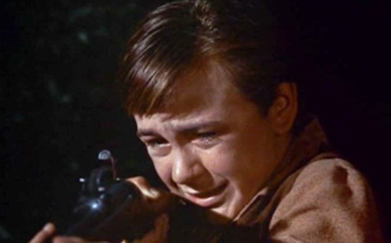 No one from my generation can forget the moment when Travis put Ol 'Yeller down. Still from Walt Disney's  Old Yeller  (1957) (accessed 6/10/2018).