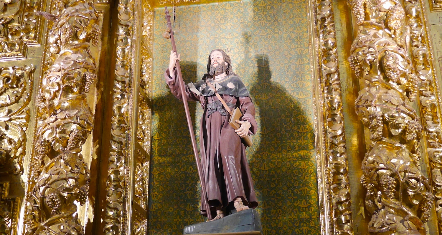 James the Great is the patron saint of Spain. How is this connection made, you ask? Good question! I captured this image of James in the Astorga cathedral. He is cast as a pilgrim with a staff and drinking gourd, book, and shells on his shoulders.