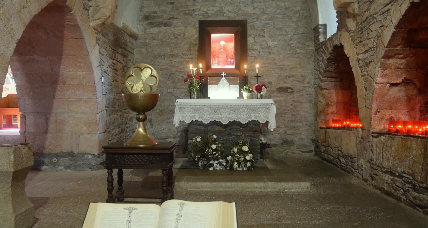 A view to the altar. Note the large model of a cup on a table.