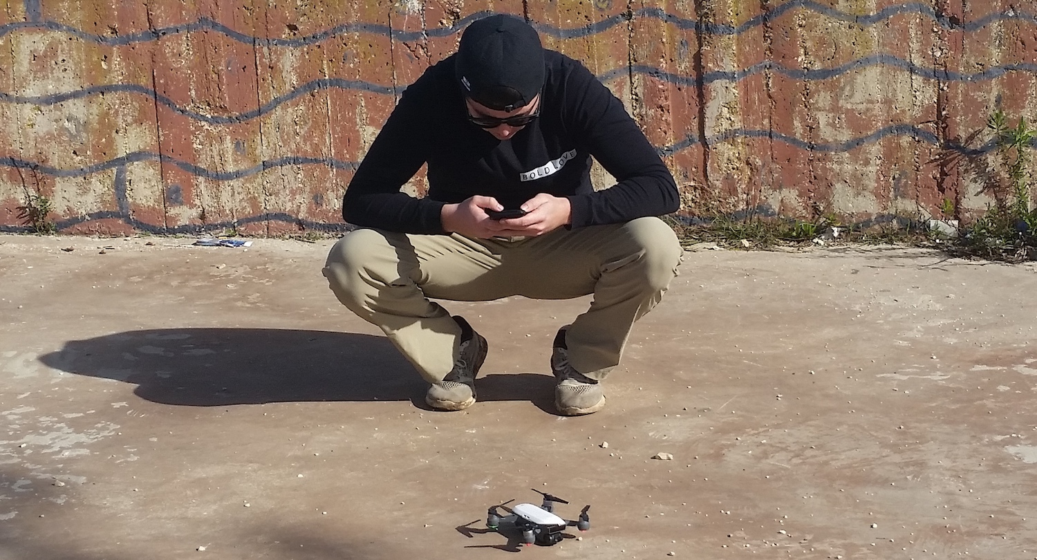 Cody, his phone, and his drone. Nazareth, Israel.