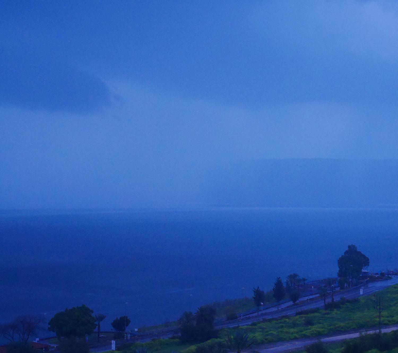 Rain moves across the Sea of Galilee.