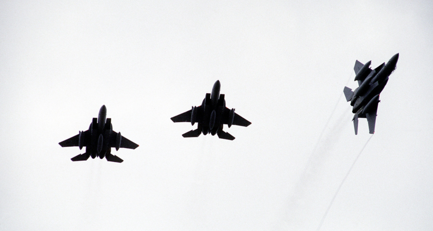 One slips out of formation. Image from https://nara.getarchive.net/media/an-f-15-eagle-aircraft-breaks-out-of-formation-with-two-other-f-15s-while-participating-56607d. Accessed 6/5/2019.