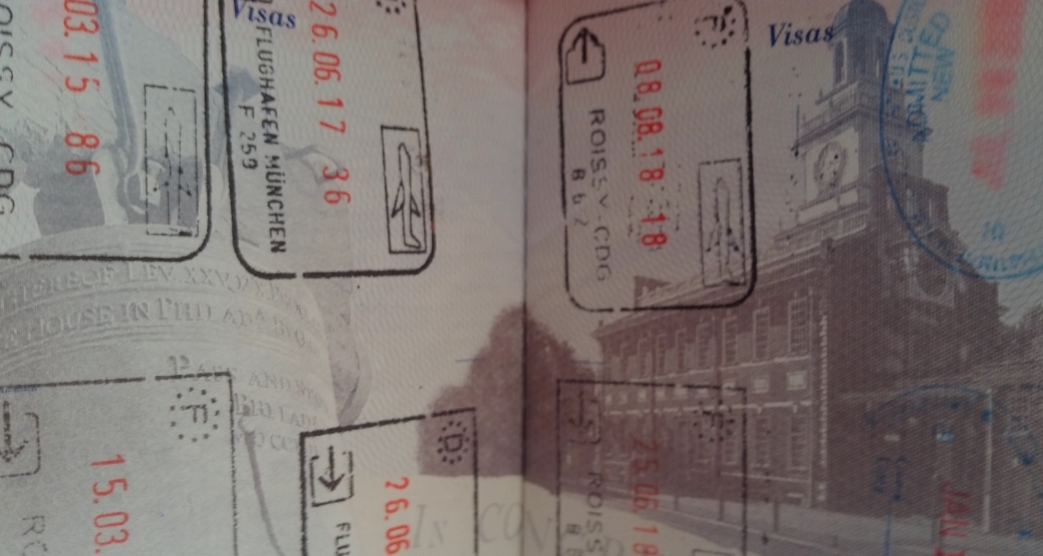 Stamp collecting in one's passport is one way to remember your travels.
