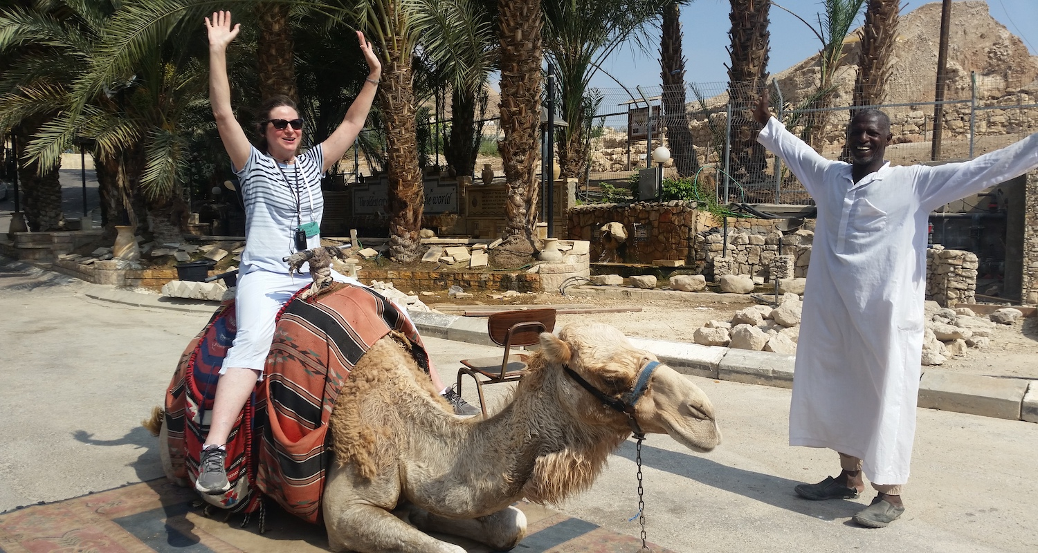 Janet wings it on a camel in Jericho.