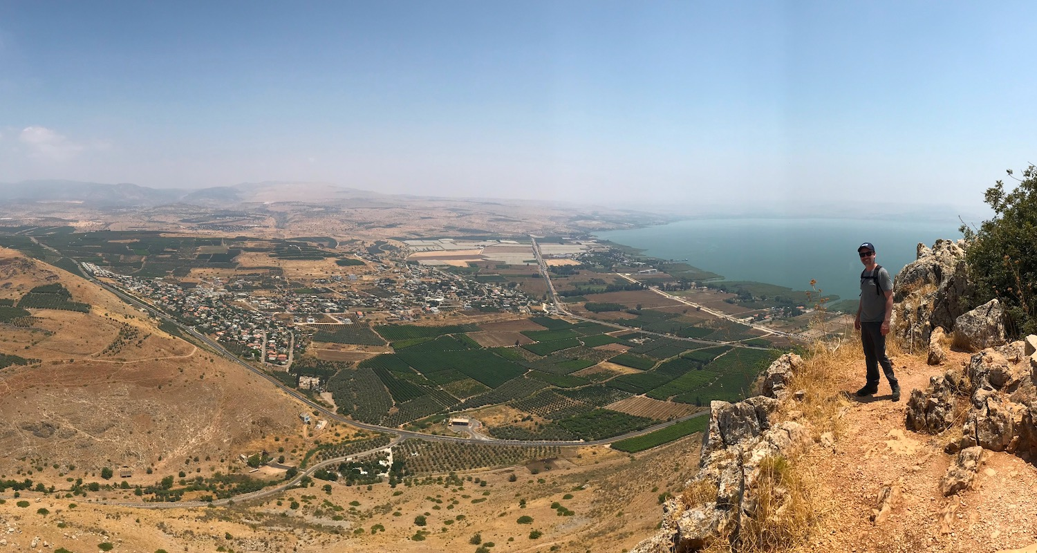 Seth tempts gravity on the edge of Mt Arbel. Below him is the Plain of Genesaret and the Sea of Galilee.