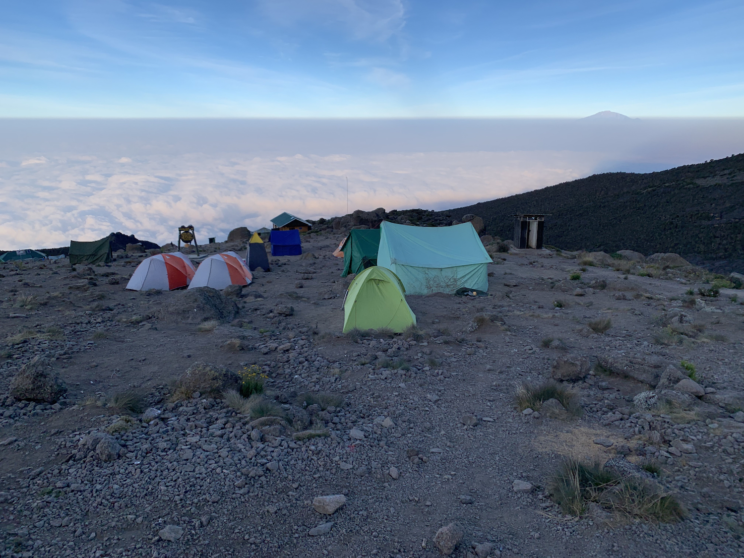 A blanket of clouds swaddled the mountain. Meru is visible on the horizon to the right. Photograph by Bryan, a member of our Kandoo Adventures team.