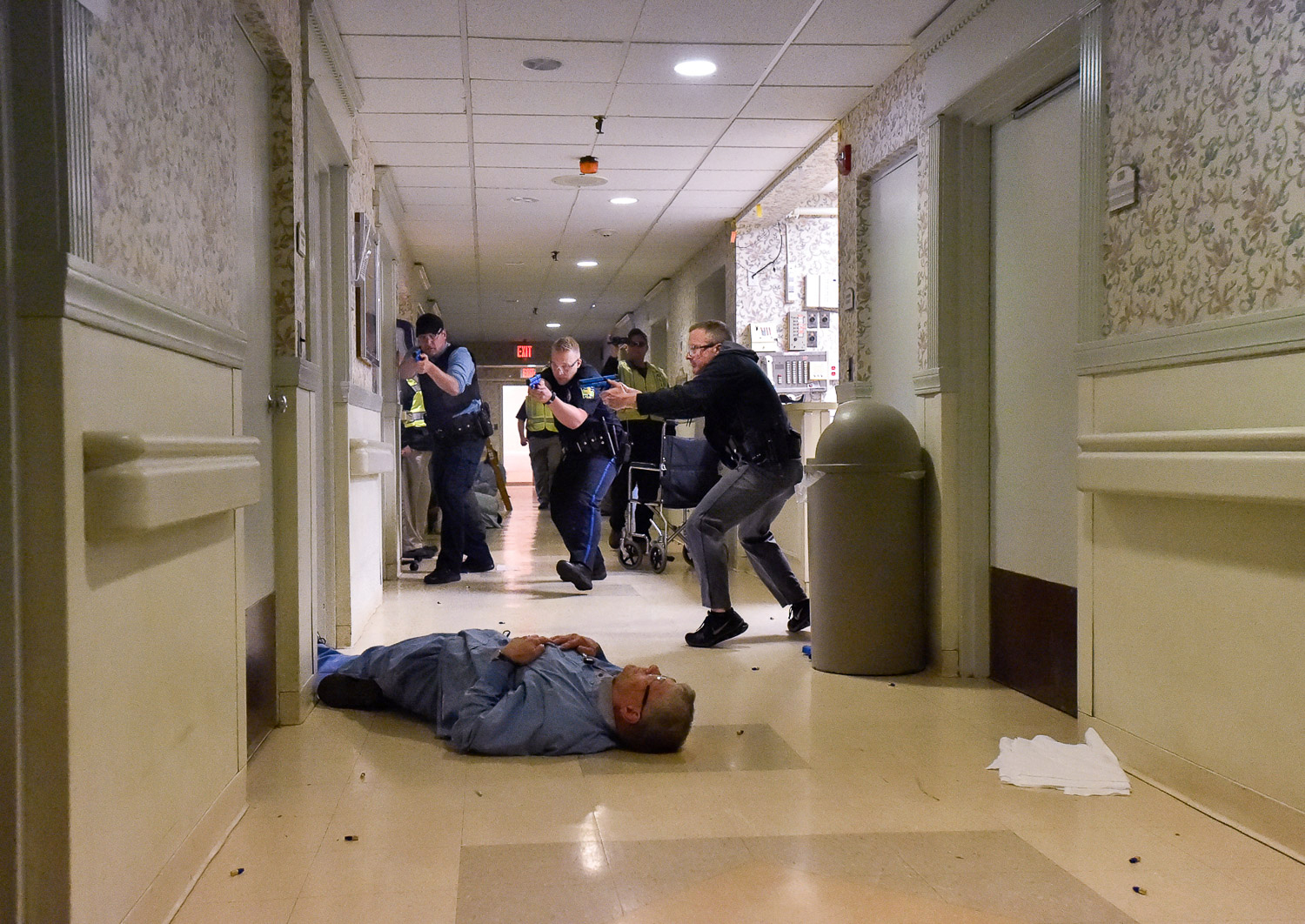 Nikon D4s, 1/400 @ f/4.5, ISO 16,000, 17-35mm  Melrose Police Sgt. Josh Crowley, Patrolman Dale Parsons and Sgt. Dave Mackey take part in an active shooter drill inside Wingate at Melrose, Friday, May 12, 2017. [Wicked Local Staff Photo / David Sokol]