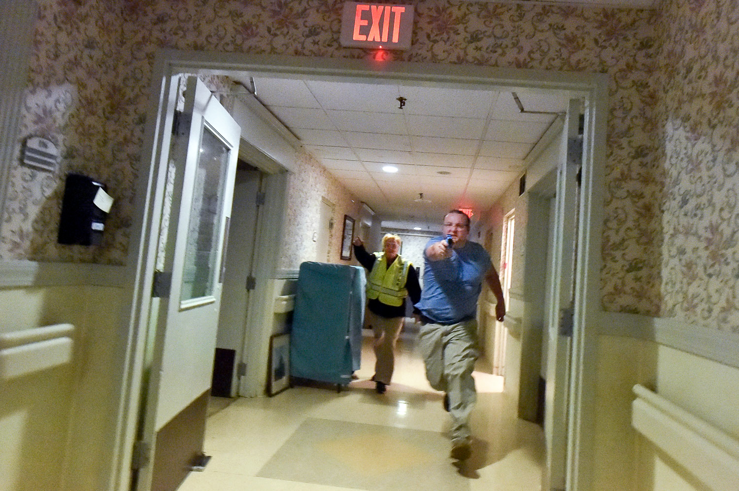 Nikon D4s, 1/320 @ f/4, ISO 20,000, 17-35mm  Melrose Patrolman Levi DiFranza charges down the hallway as he plays the role of the assailant during an active shooter drill inside Wingate at Melrose, Friday, May 12, 2017. [Wicked Local Staff Photo / David Sokol]