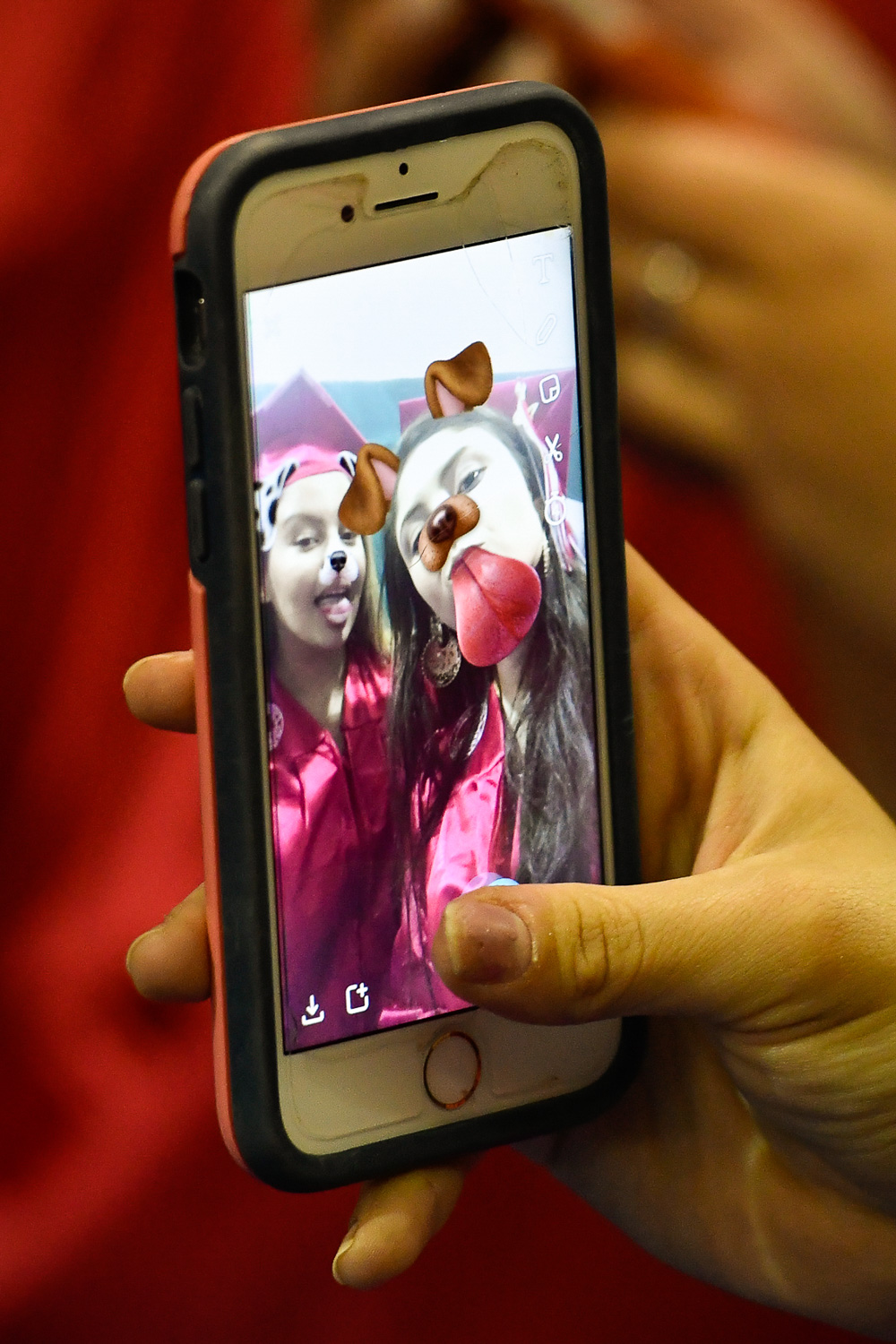 Nikon D500, 1/320 @ f/2.8, ISO 1600, 70-200mm  Roufaida Bouri and Halima Castano take a Snapchat selfie before the start of the Somerville High School Class of 2017 Graduation Exercises at the Tufts University Gantcher Center, Monday, June 5, 2017. [Wicked Local Staff Photo / David Sokol]
