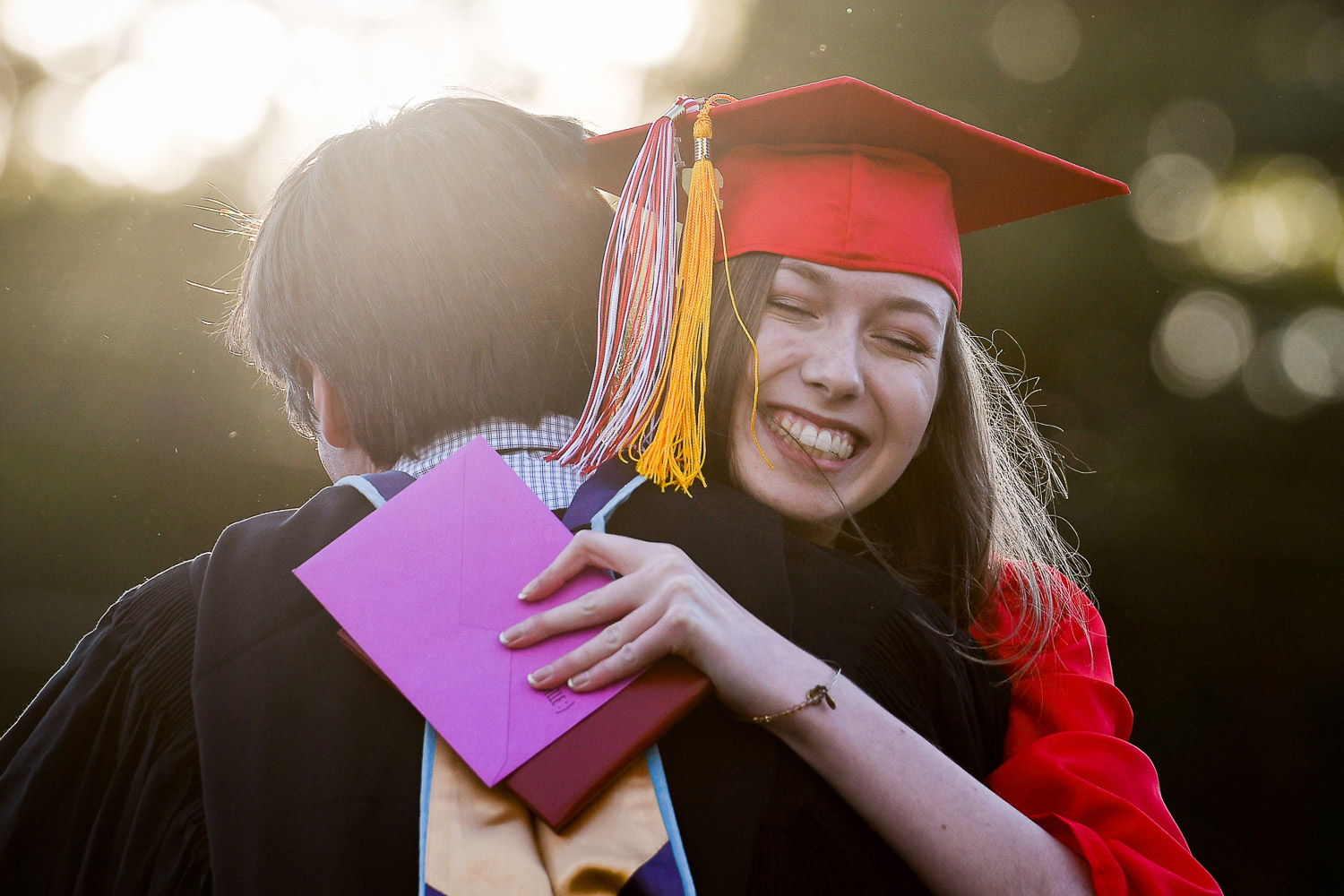 Nikon D500, 1/1,000 @ f/4.0, ISO 100, 70-200mm  Bridget Bright gets a hug after receiving her diploma during the Melrose High School Graduation Ceremony at the Fred Green Memorial Field, Friday, June 2, 2017. [Wicked Local Staff Photo / David Sokol]