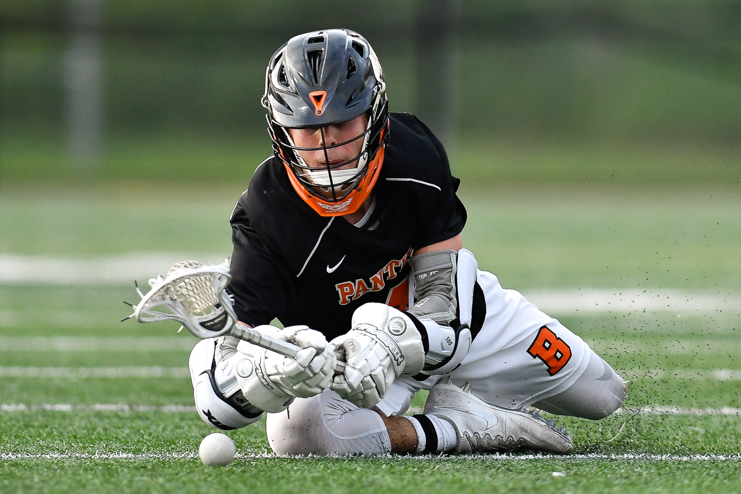 Nikon D500, 1/2000 @ f/2.8, ISO 8000, 300mm  Nick DiLuiso of Beverly reaches for a loose ball during their Division 2 North tournament game win over Wakefield, 7-6, at Concord Carlisle High School, Saturday, June 10, 2017. [Wicked Local Staff Photo / David Sokol]