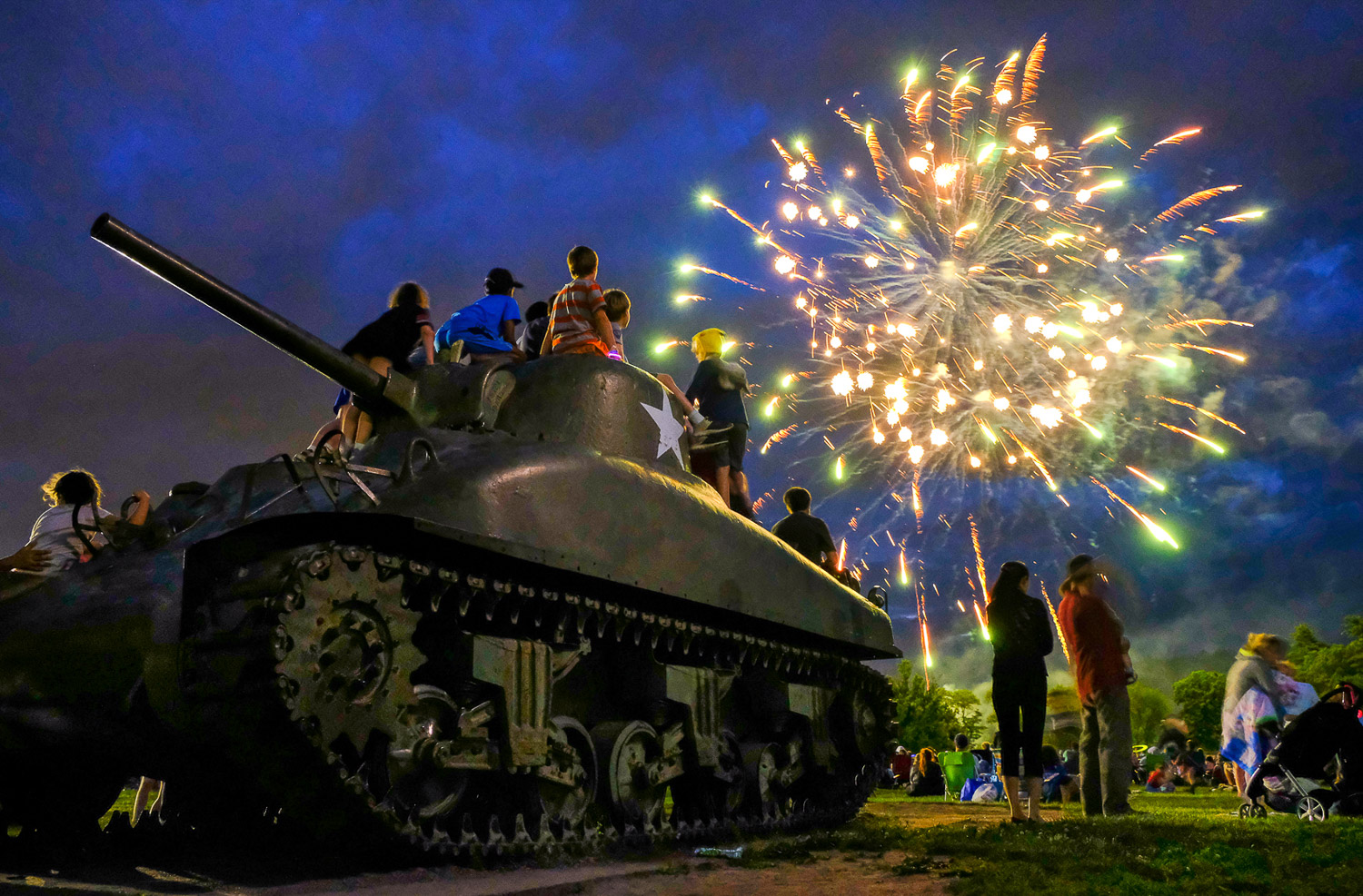 Fuji X-T2, .5 sec @ f/4, ISO 6400, 18-55mm  Children gather on top of the tank at Patton Park in Hamilton as they enjoy a fireworks display and music at the conclusion of the Community Block Party, Sunday, June 25, 2017. [Wicked Local Staff Photo / David Sokol]