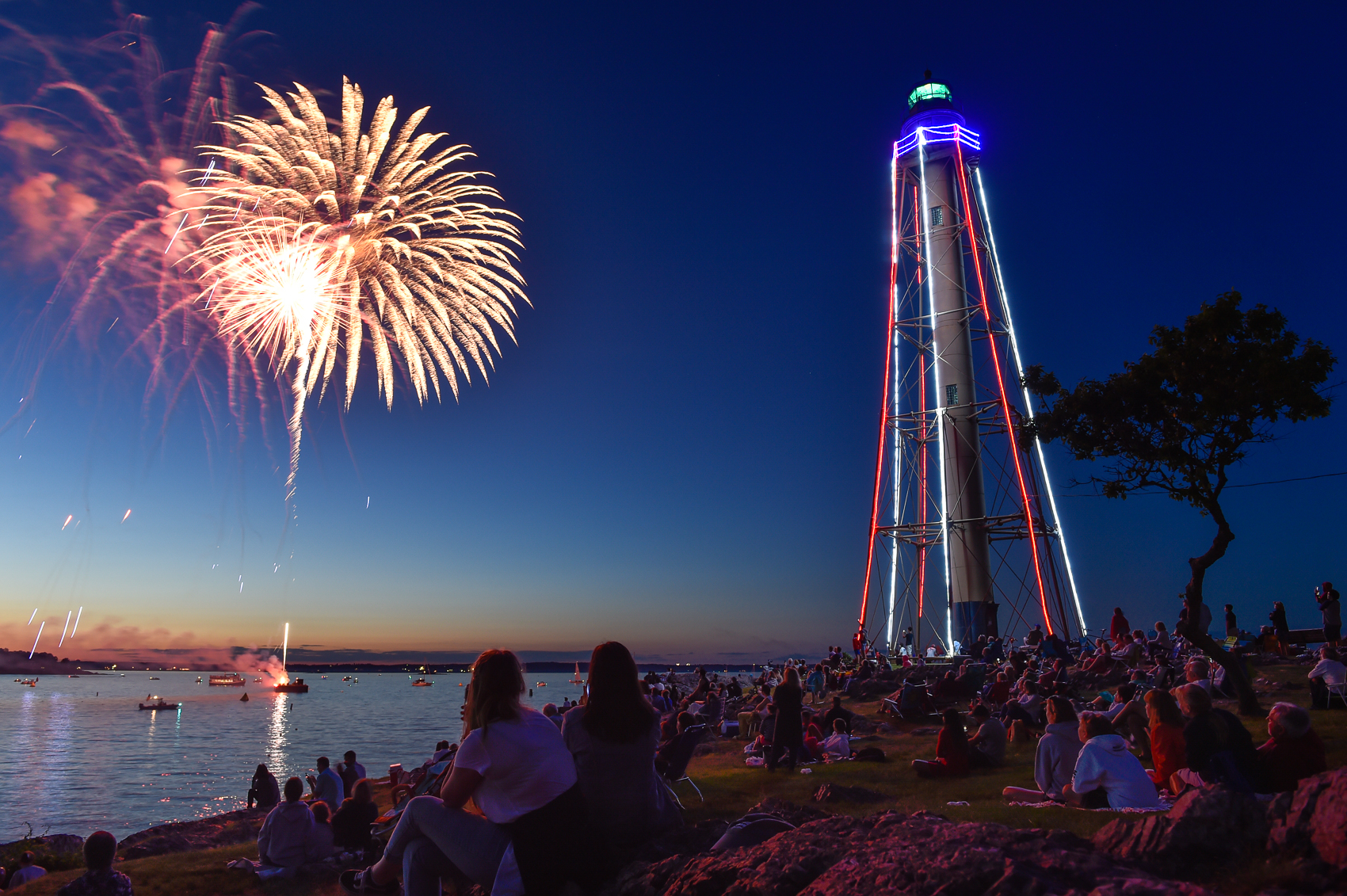 Nikon D4s, 1 sec @ f/6.3, ISO 400, 24-70mm  People gather at Marblehead Lighthouse Park to view the Fourth of July fireworks display over Marblehead Harbor, Tuesday, July 4, 2017.  [Wicked Local Staff Photo / David Sokol]