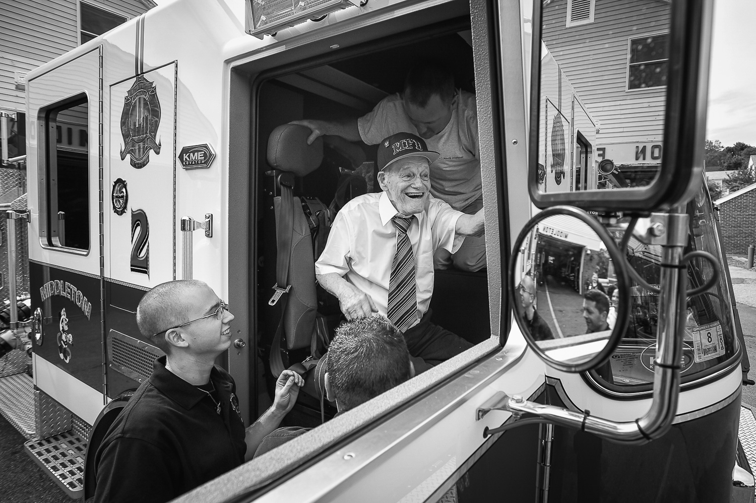 Nikon D4s, 1/250 @ f/5.6, ISO 100, 17-35mm  Honorary Middleton firefighter Bobby Jensen, 89, is helped into Middleton Engine 2 as he prepares to go for a ride around the block during his visit at the Middleton Fire Department, Thursday, Sept. 14, 2017.
