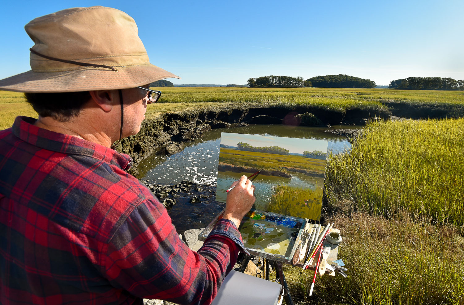 Nikon D4s, 1/400 @ f/8, ISO 200, 17-35mm  Professional artist Mark Shasha uses oil paints as he works on a painting looking over a marsh along Argilla Road in Ipswich, Wednesday, Oct. 4, 2017.