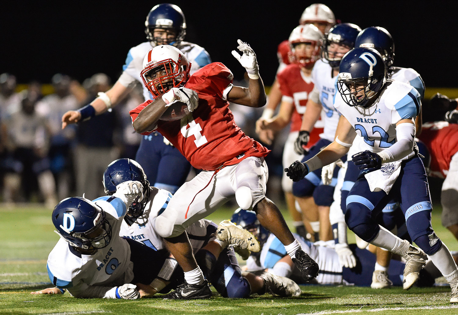 Nikon D4s, 1/1250 @ f/2.8, ISO 8000, 300mm  Isaac Seide of Melrose breaks free from a tackle while running the ball during their 14-10 win over Dracut at Melrose High School, Friday, Oct. 27, 2017.