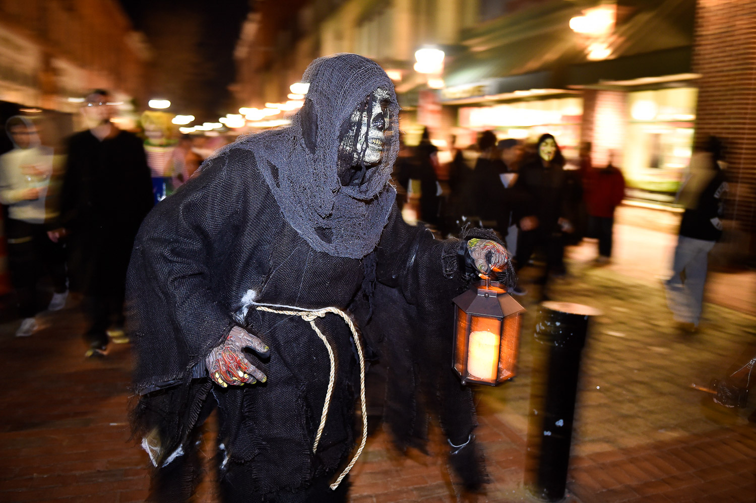 Nikon D4s, 1/10 @ f/2.8, ISO 1600, 24-70mm  Dan Nadeau, from Salem, makes his way down the Essex Street Pedestrian Mall dressed as a ghoul on Halloween night in downtown Salem, Tuesday, Oct. 31, 2017.