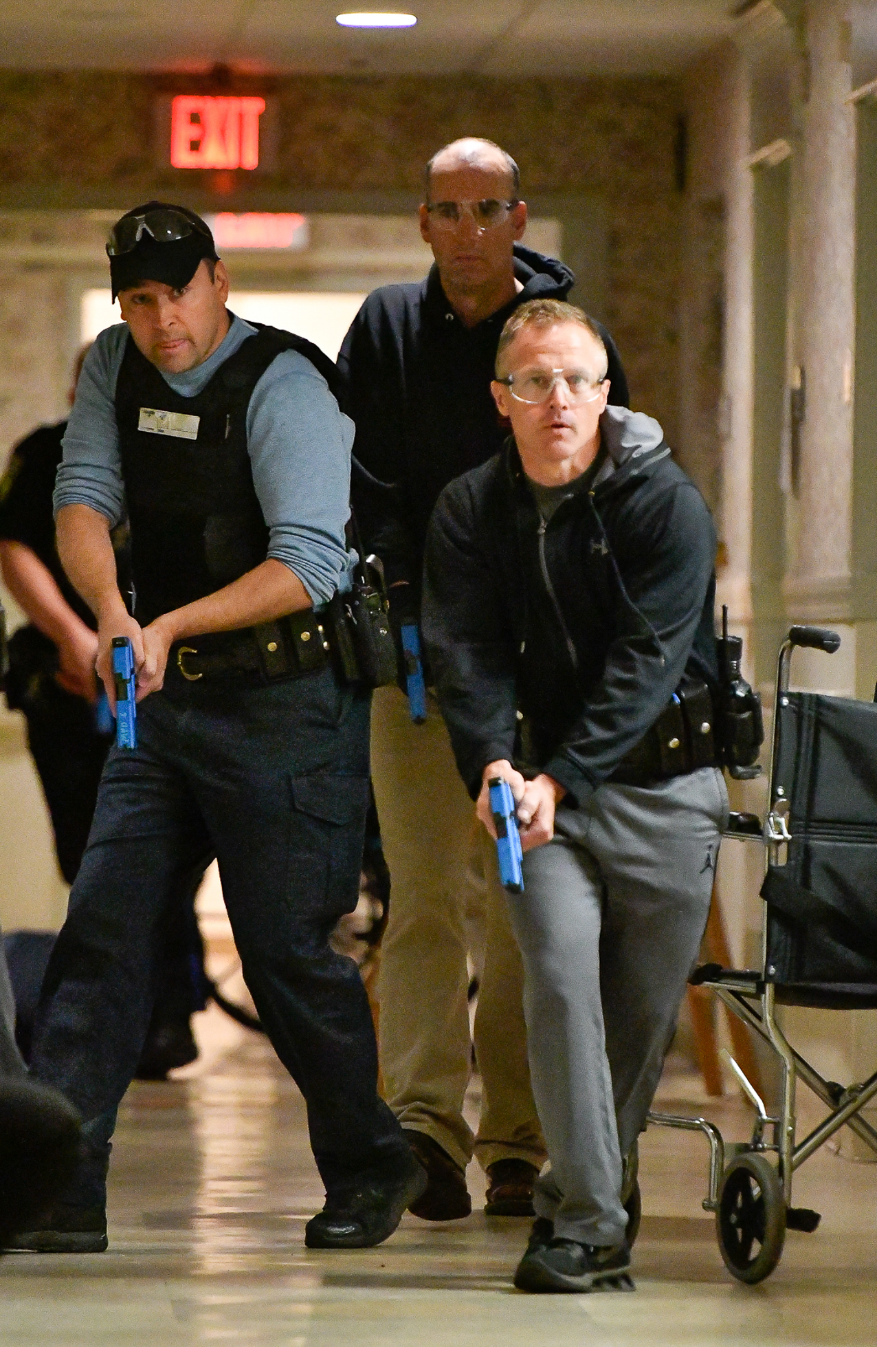 Melrose Police Sgt. Josh Crowley, Patrolman Brian Ladner and Sgt. Dave Mackey take part in an active shooter drill inside Wingate at Melrose, Friday, May 12, 2017. [Wicked Local Staff Photo / David Sokol]
