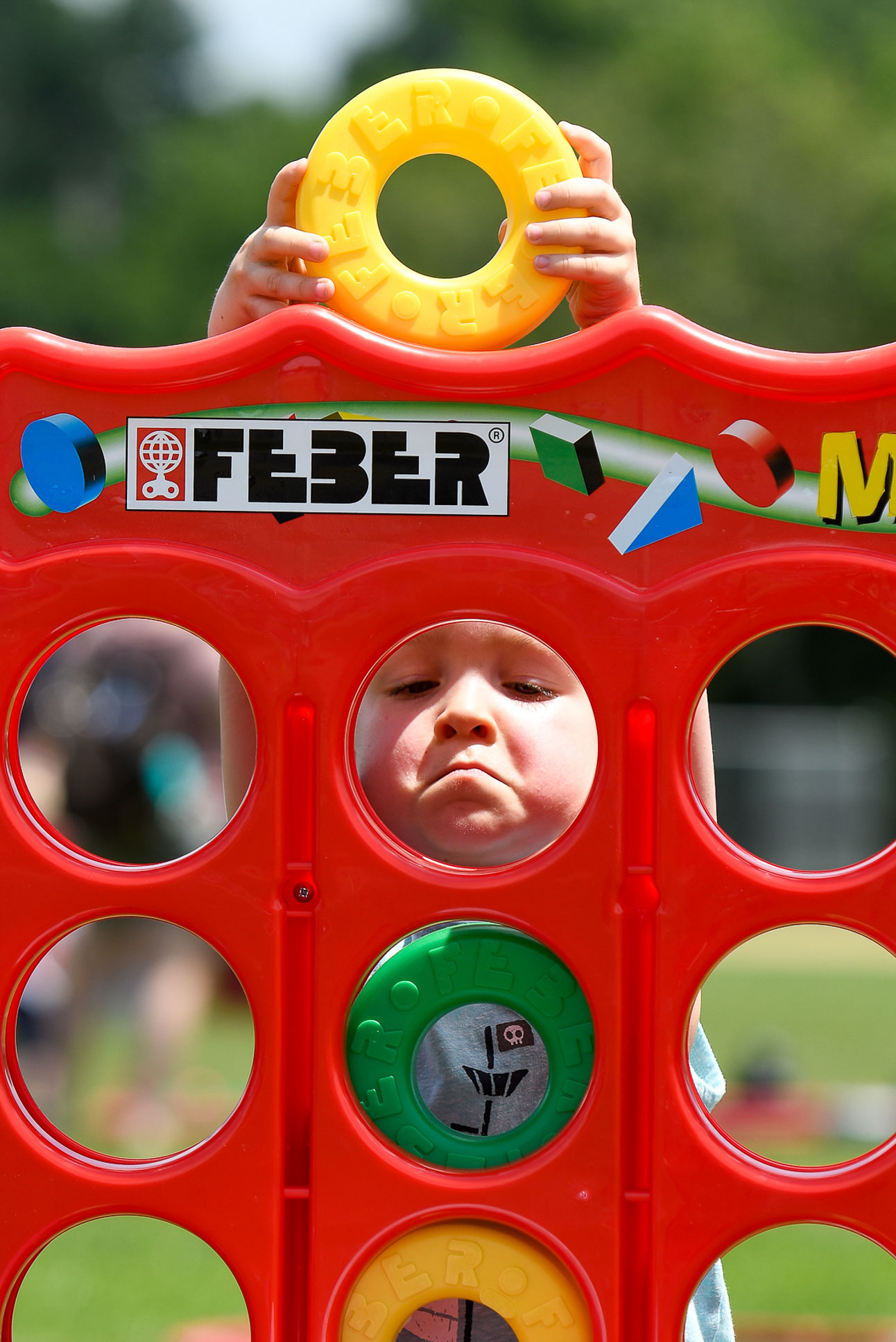 """Benjamin Smith, 4, plays a game of """"Mega 4 In Line"""" during the Danvers Family Festival Field Day & Scoop-ah-bowl at Plains Park, Saturday, July 1, 2017. [Wicked Local Staff Photo / David Sokol]"""