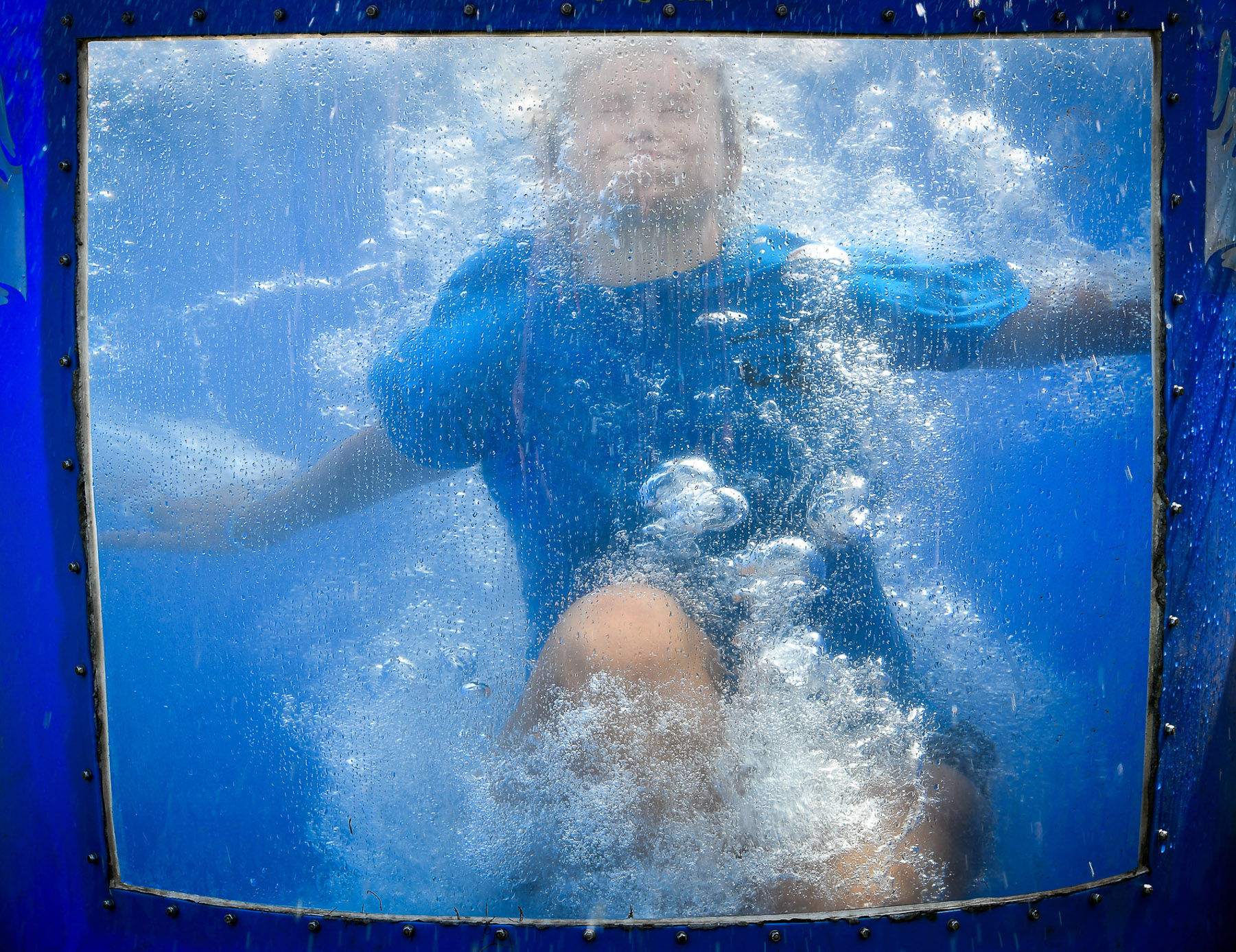 Danielle Dedeo, Adventure Camp councilor, gets soaked in the Dunk Tank during the Kids Carnival at Lynch Park, Friday, Aug. 4, 2017. [Wicked Local Staff Photo / David Sokol]