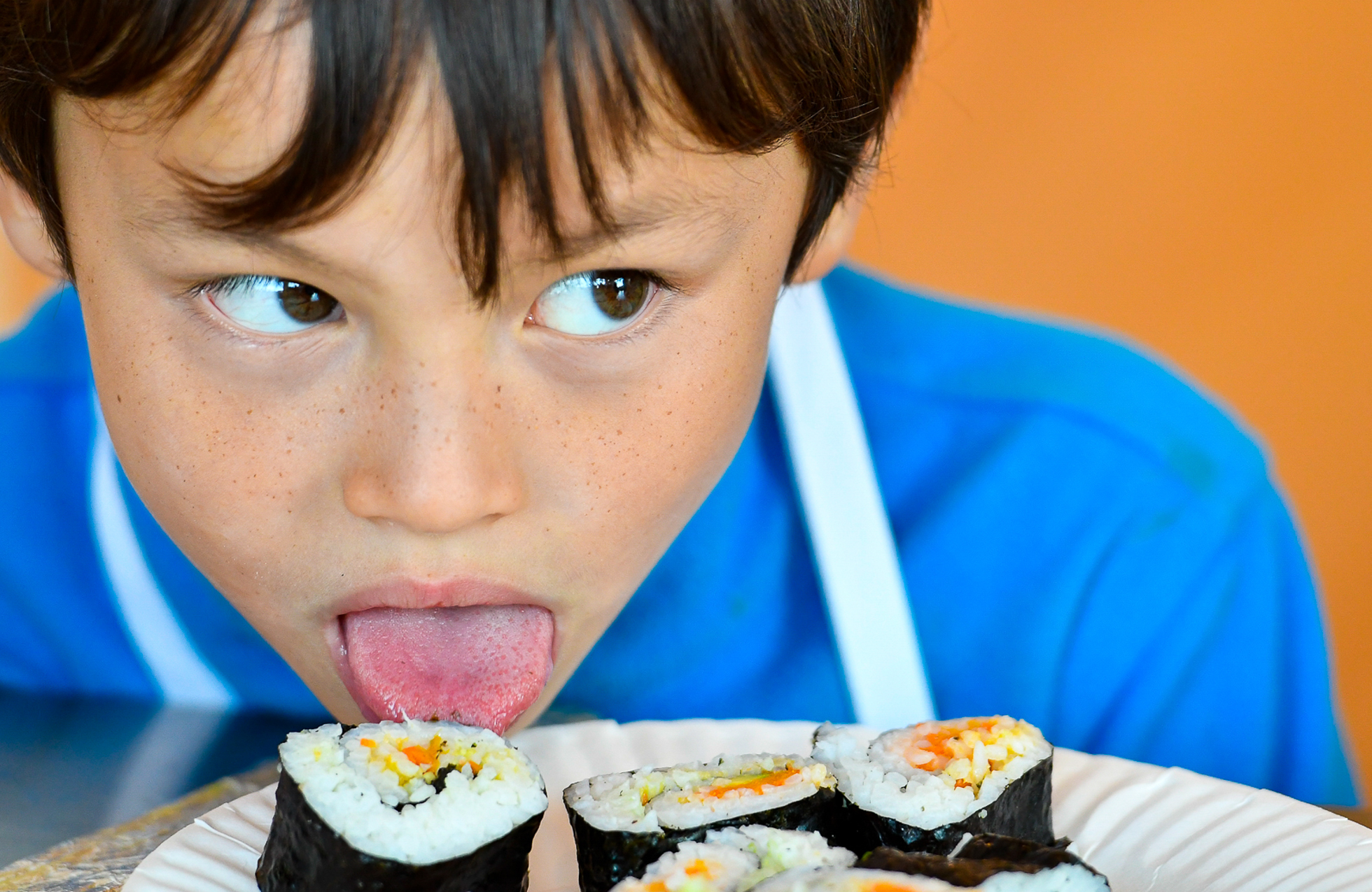 Joey Duffield, 8, uses his tongue to get a taste of sushi he made during a cooking class at Taste Buds Kitchen in Beverly, Wednesday, Oct. 18, 2017. [Wicked Local Staff Photo / David Sokol]