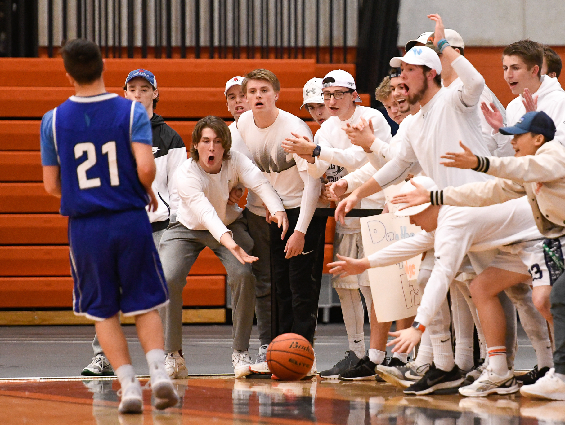 Beverly fans react to an out of bounds ball being chased by Justin Roberto of Danvers during their game at Beverly High School, Tuesday, Jan. 3, 2016. [Wicked Local Staff Photo / David Sokol]