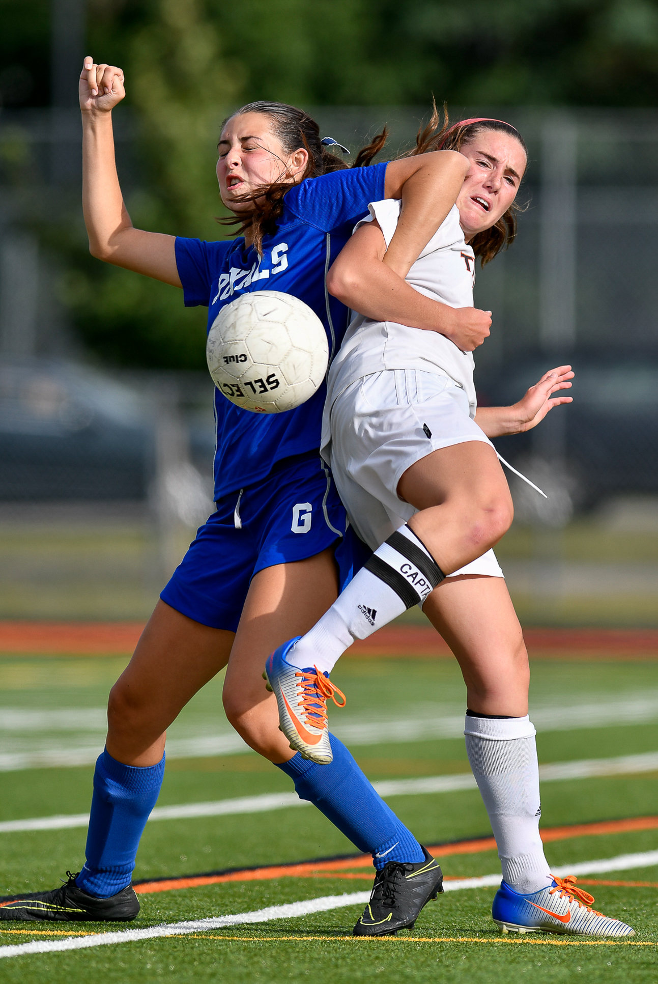 Casey Smith of Georgetown gets tangled up with Grace Evans of Ipswich as they both charge after a loose ball during their game at Ipswich High School, Friday, Sept. 8, 2017. [Wicked Local Staff Photo / David Sokol]