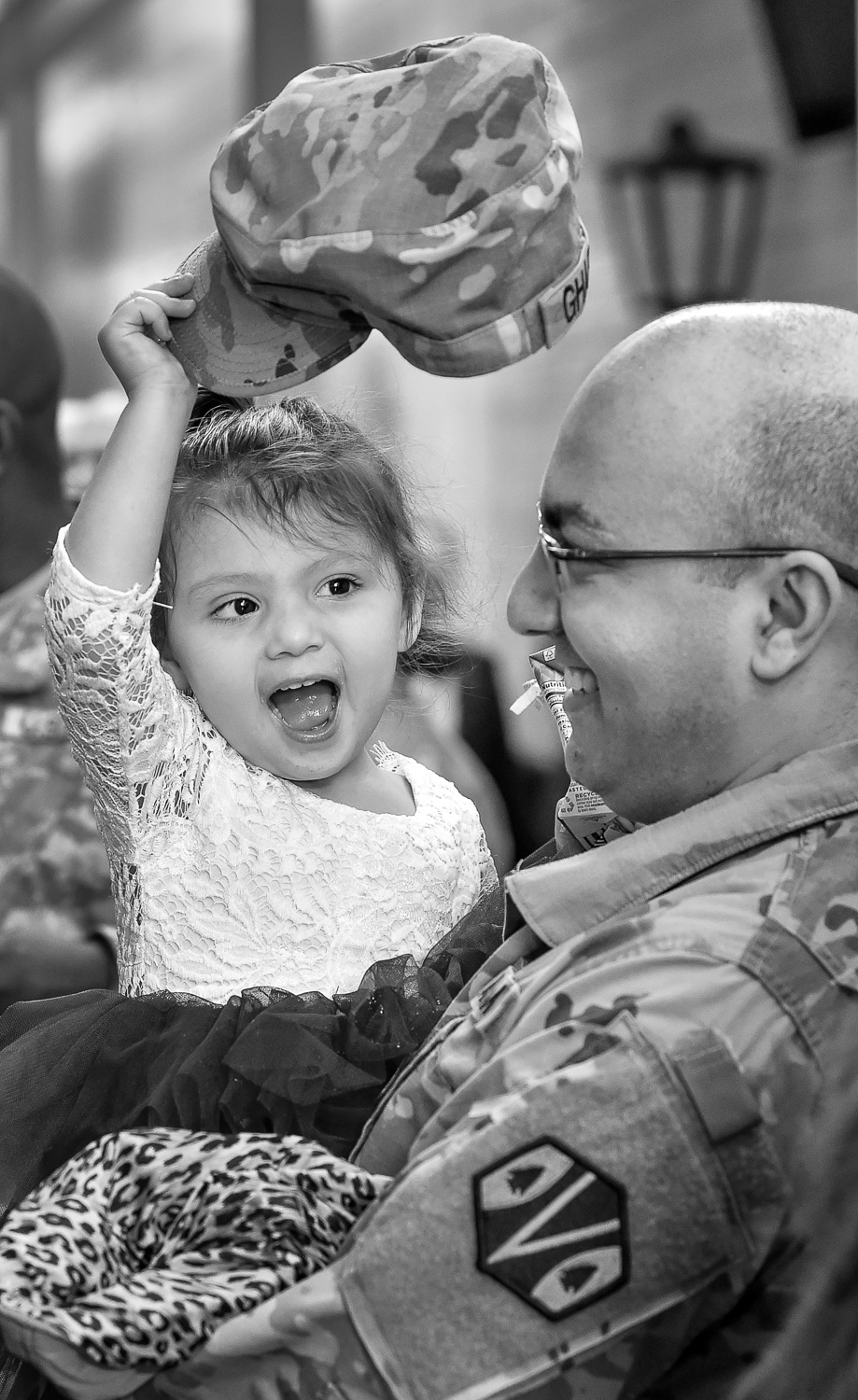 Nikon D4s, 1/250 @ f/4, ISO 2500, 70-200mm  Nora Charony, 2, plays with her father Omid Charony's, of Hanscom, hat at the conclusion of the 151st Regional Support Group Deployment Ceremony at Reading High School on Sunday, Jan. 21, 2018. Soldiers from the 151st Regional Support Group, Massachusetts Army National Guard will soon be deployed to southwest Asia for nine months. [Wicked Local Staff Photo / David Sokol]
