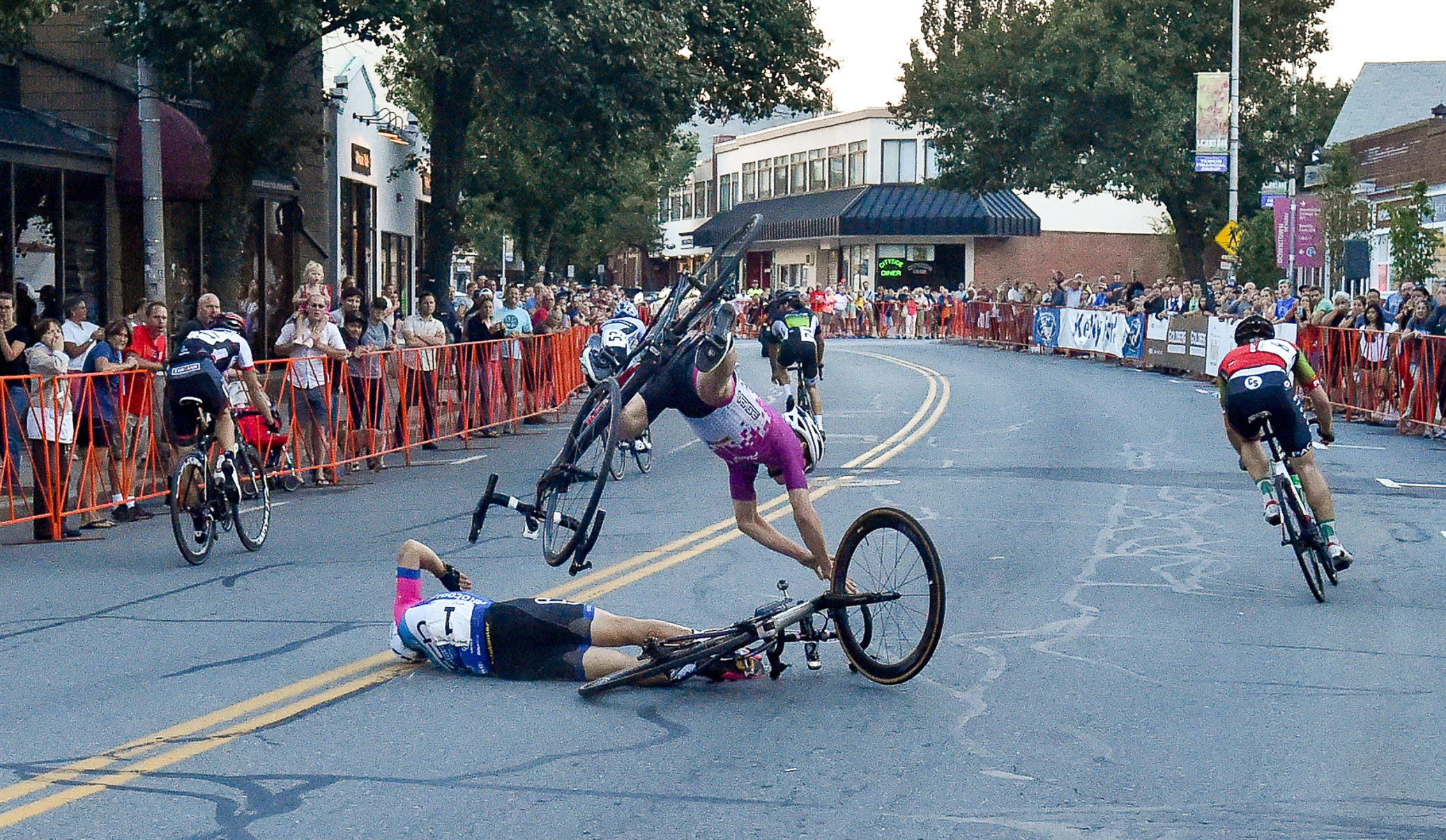 3rd, Sports Photo  Lucas Fortini is seen flying through the air after making contact Sam Rosenholtz who crashed after crossing the finish line at the conclusion of the Men's State Championship Race during The Gran Prix of Beverly on Wednesday, July 26, 2017.