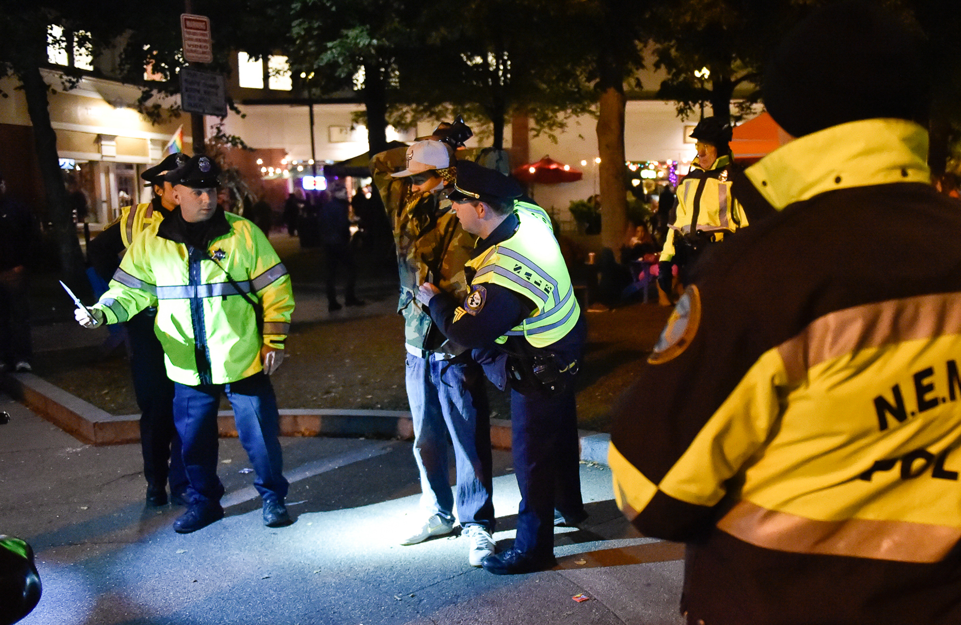 1st Place, Spot News Photo  A Salem police officer, left, holds a switchblade knife, which was allegedly found on this man, near Washington and Essex Street on Halloween night in Salem on Monday, Oct. 31, 2016.