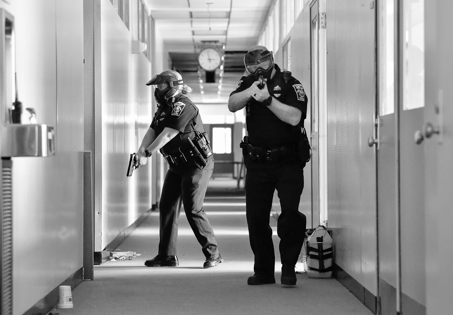 Nikon D4s, 1/1,000 @ f/4, ISO 10,000  North Andover police officer Ashley Kneeland, left, and officer Jason Wedge, right, take part in an active shooter training at Osgood Landing on Wednesday, April 18, 2018. [Wicked Local Staff Photo / David Sokol]