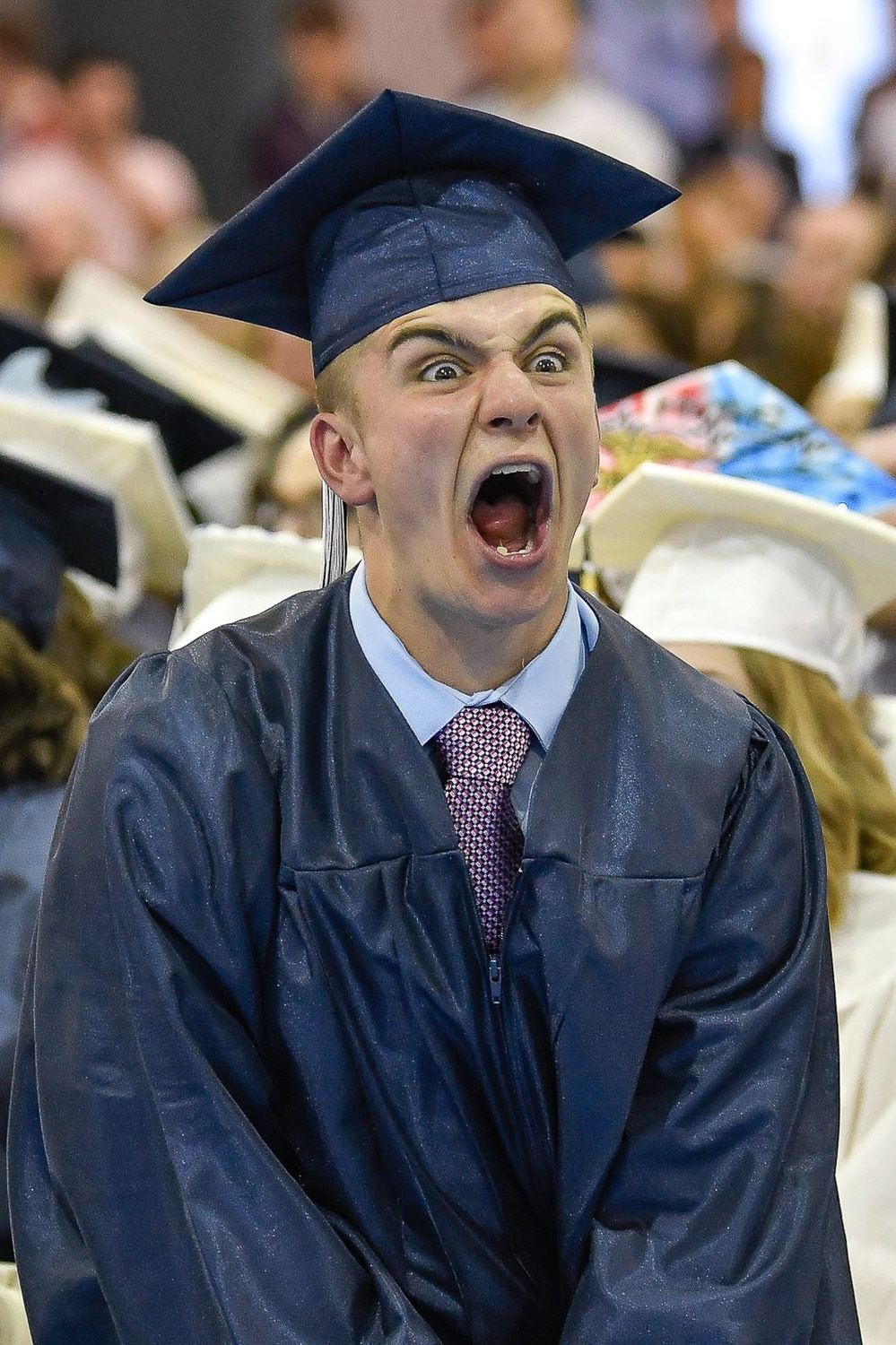 Second Place Personality:  Joseph Camara cheers on classmates during the Medford High School class of 2018 commencement exercises at the Gantcher Family Sports and Convocation Center at Tufts University on Wednesday, June 6, 2018. [Wicked Local Staff Photo / David Sokol]