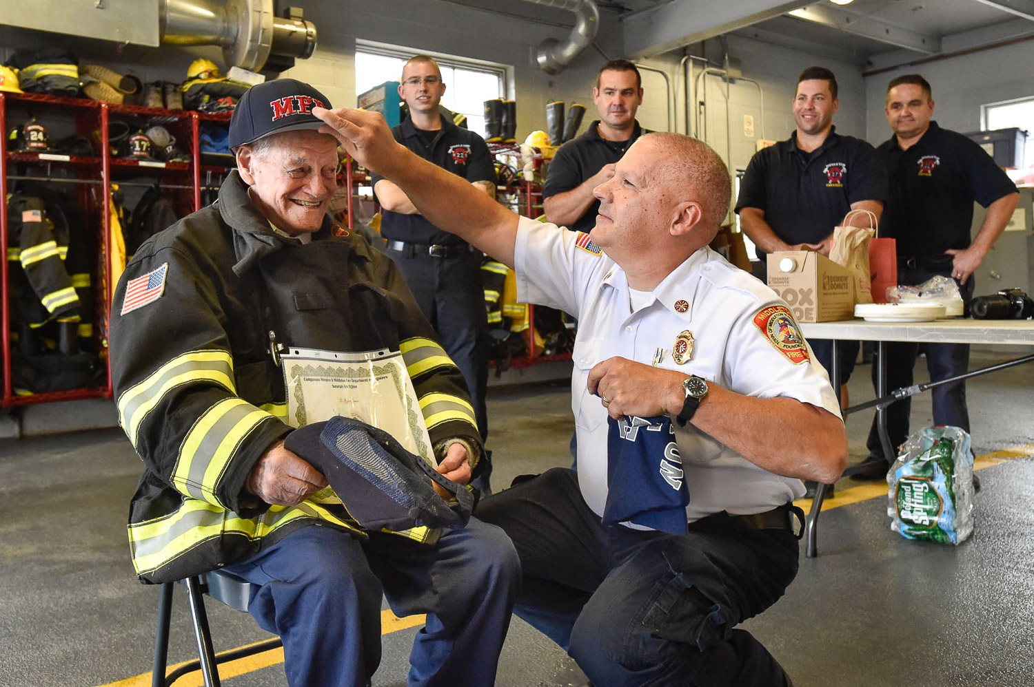 4 of 9 Middleton Fire Chief Thomas Martinuk put a brand new Medford Fire hat on Bobby Jensen, a honorary Middleton firefighter during his visit at the Middleton Fire Department, Thursday, Sept. 14, 2017. [Wicked Local Photo / David Sokol]
