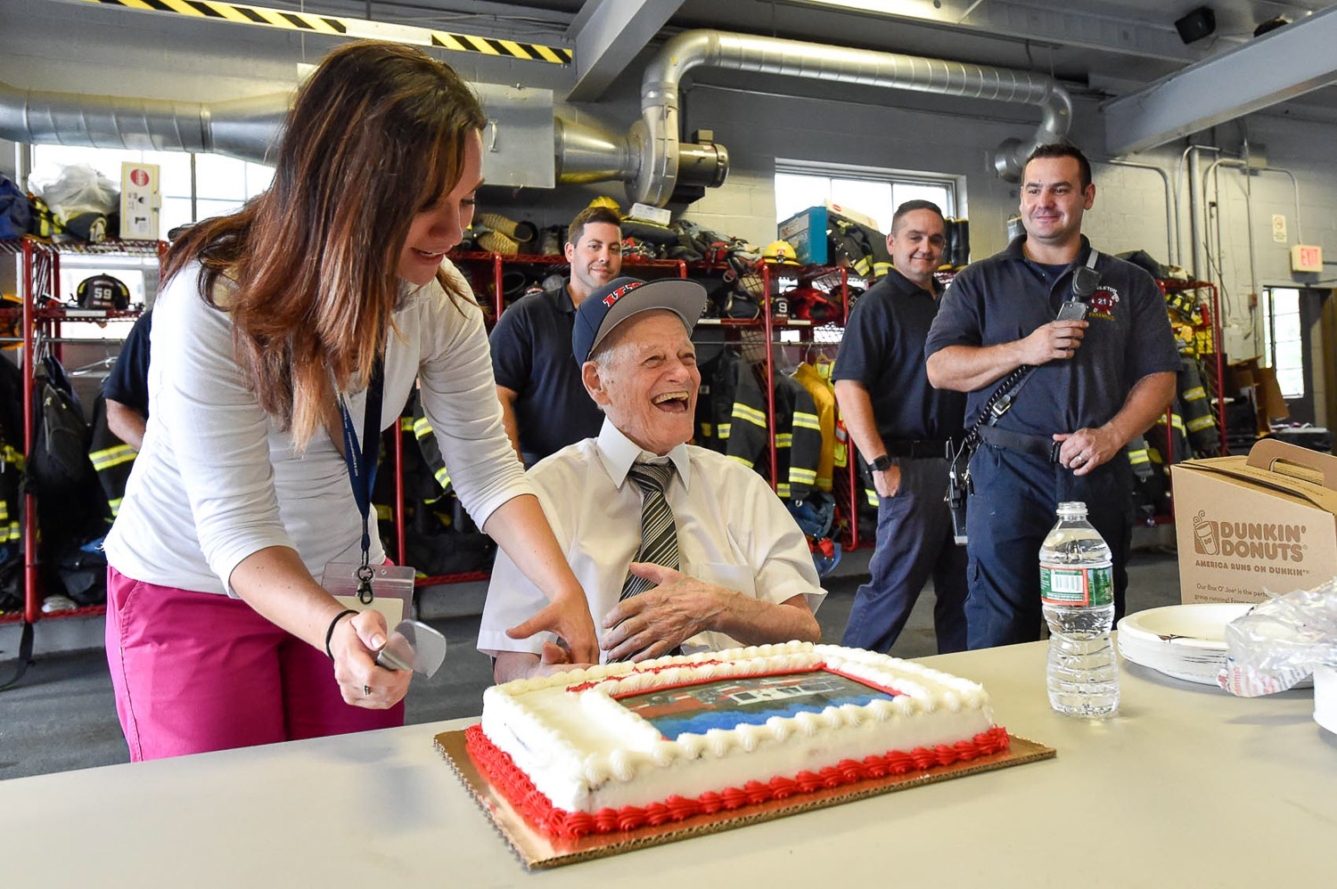 6 of 9 Maureen Brancato, Hospice Nurse at Compassus prepares the cake for Bobby Jensen, a honorary Middleton firefighter, to cut during his visit to the Middleton Fire Department, Thursday, Sept. 14, 2017. [Wicked Local Photo / David Sokol]