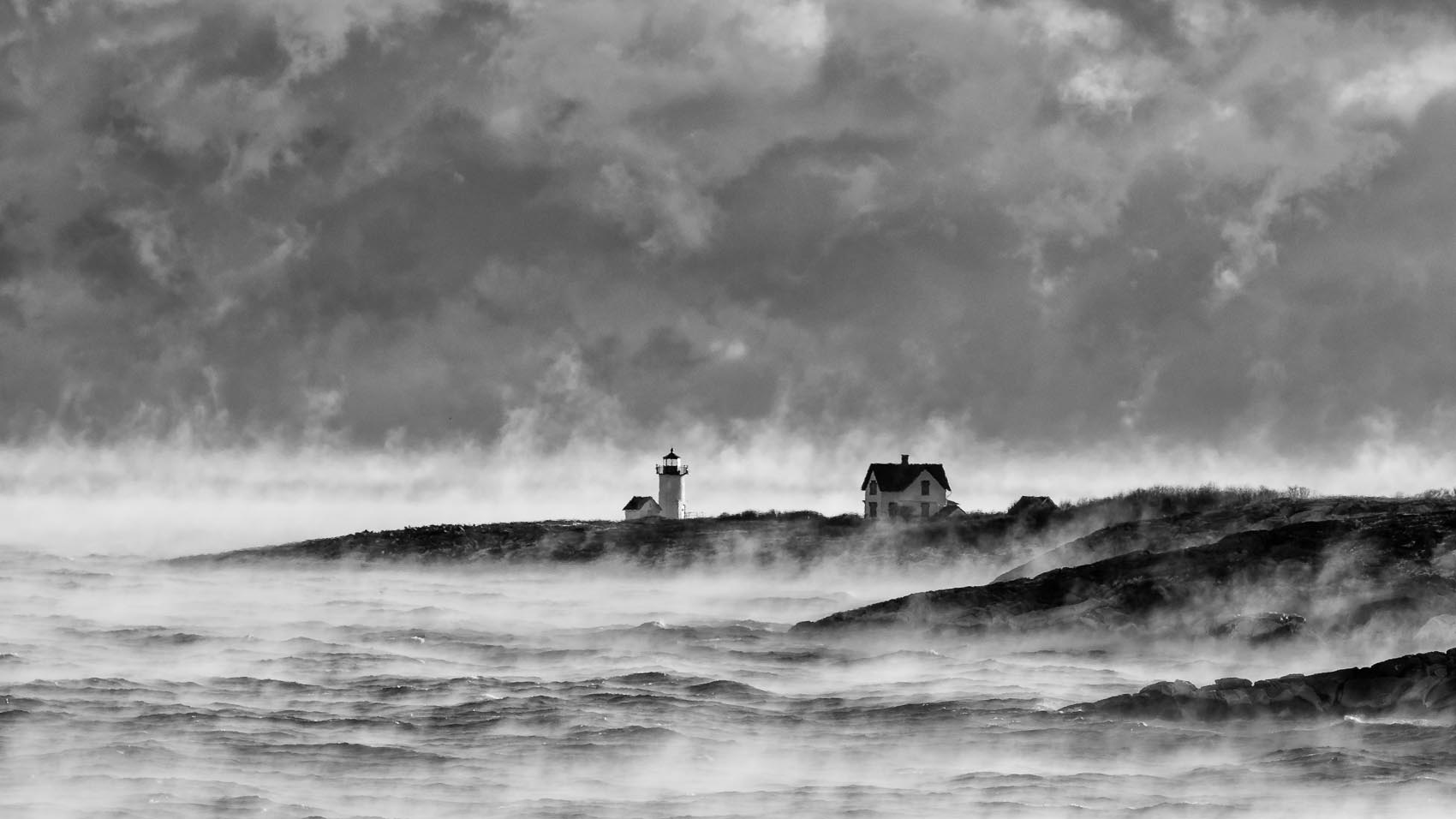 Second Place Pictorial:  Sea smoke surrounds Straitsmouth Island Light in Rockport on a 3 degree morning on Dec. 28, 2017. [Wicked Local Photo / David Sokol]