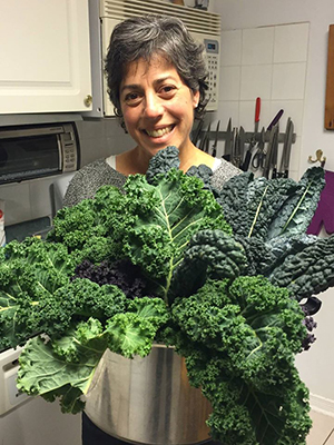 Here's me with my late night garden harvest. I can't believe these luscious green and purple kale leaves lasted till December 27th! #thelittlethings