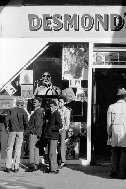 GB. ENGLAND. Brixton. School children outside Desmond's Hip City record shop in Brixton. 1973.