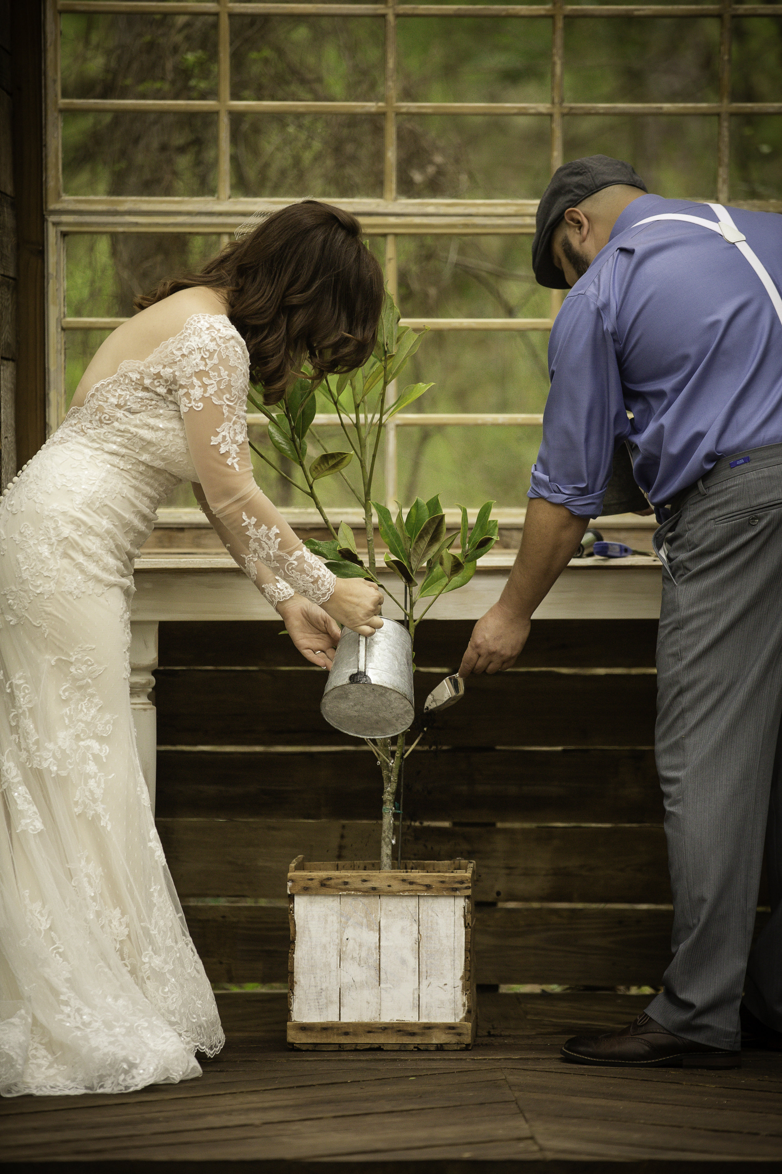 Brianna and Brad watered and spread dirt around the tree as a symbol of their love and family that they will love, care, and nurture together.