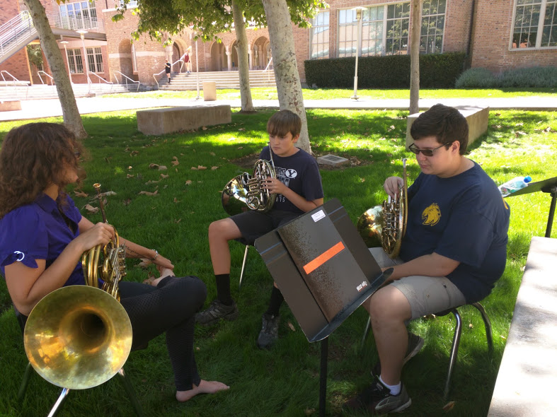 On a windy day, Dr. Hockenberry works with the horn players at El Segundo High School in Los Angeles, CA.