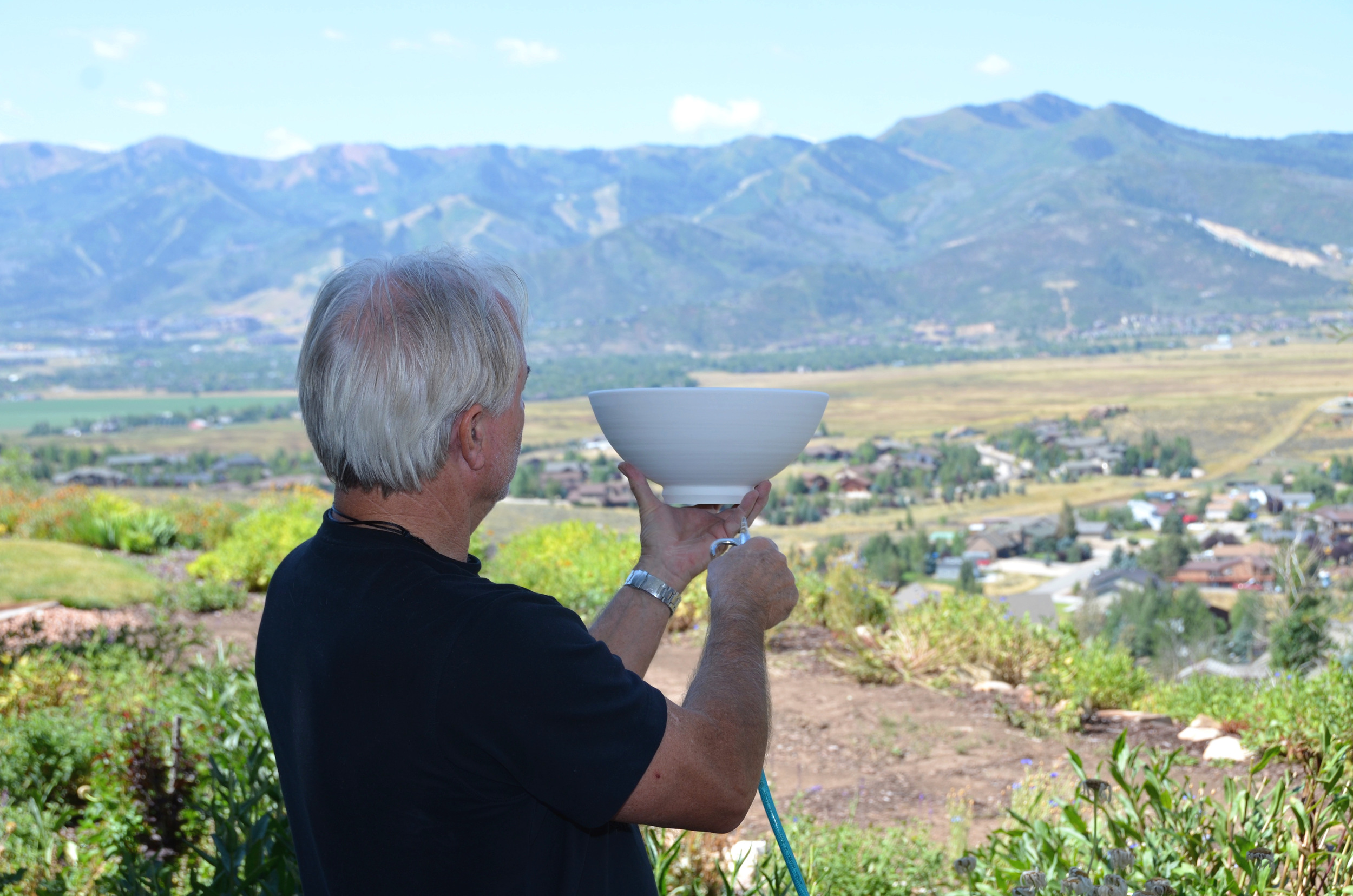 David Caldwell in their Park City Studio, preparing their porcelain pieces for hand glazing and cone 10 firing | Caldwell Pottery