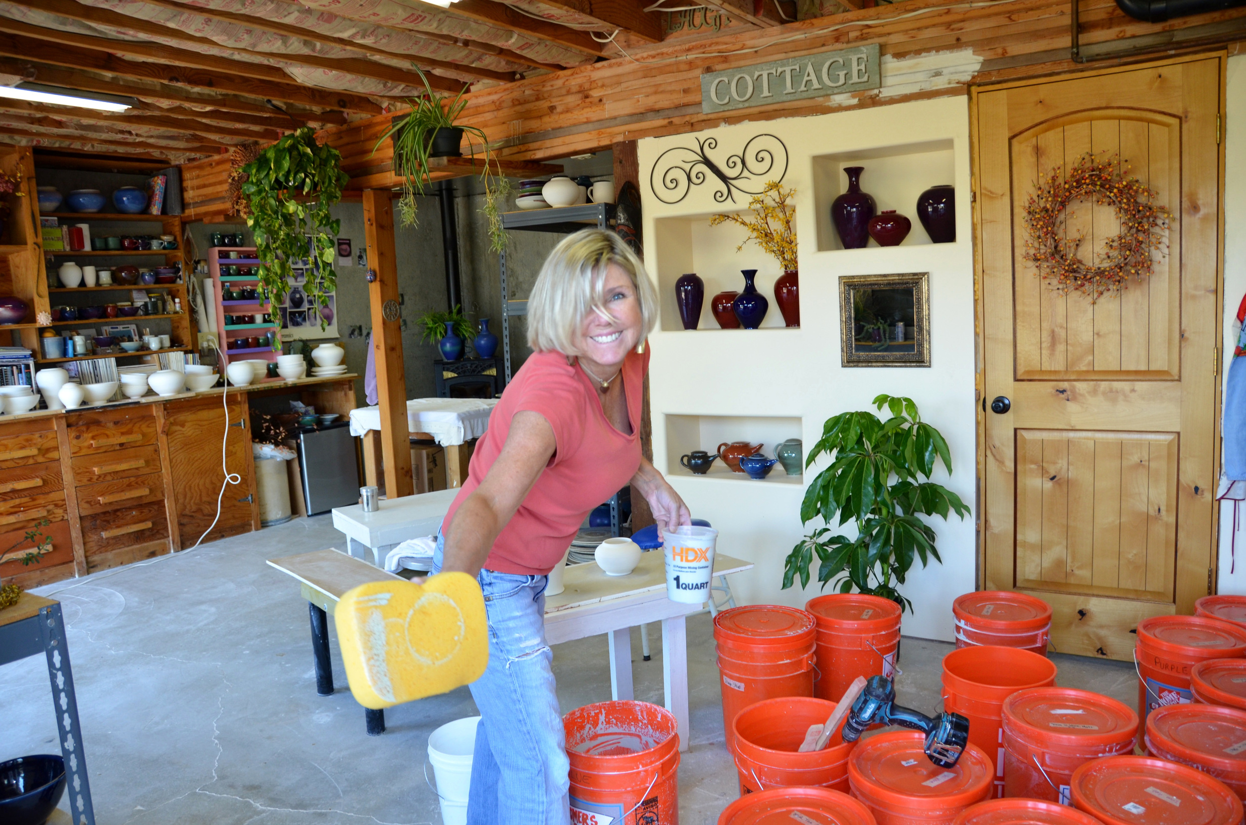 Shelly Caldwell preparing for hand glazing their porcelain pieces | Caldwell Pottery