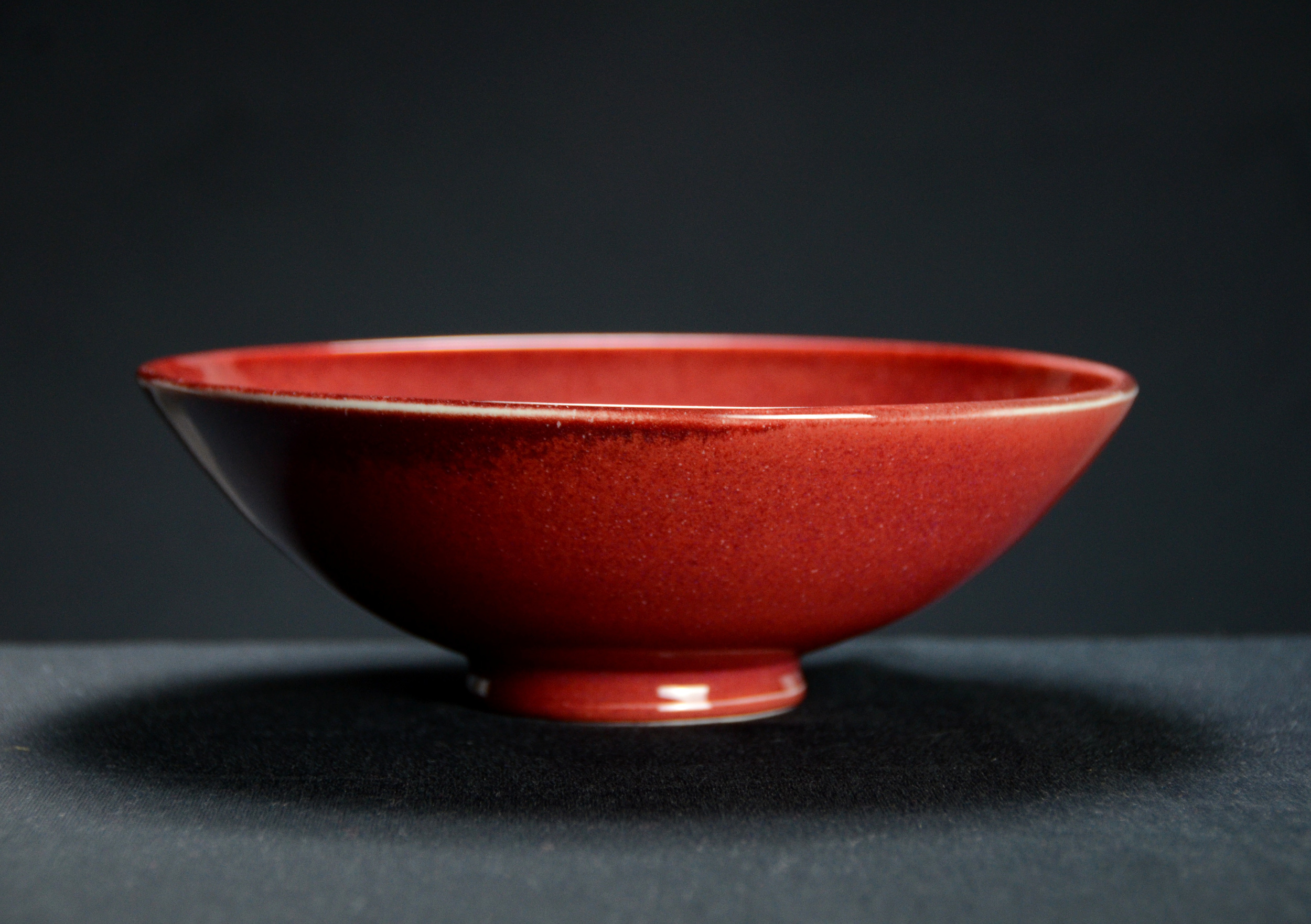 Porcelain Japanese Red Bowl | Hand thrown porcelain on a potter's wheel.  High Fired, Cone 10, Vegas Red Glaze, Hand Trimmed, Ceramic | Caldwell Pottery