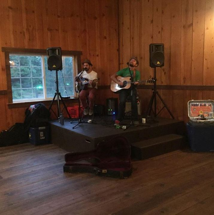 The Brothers Reed playing at the March 6th community event in the Great Western Hall at New Frontier Ranch.