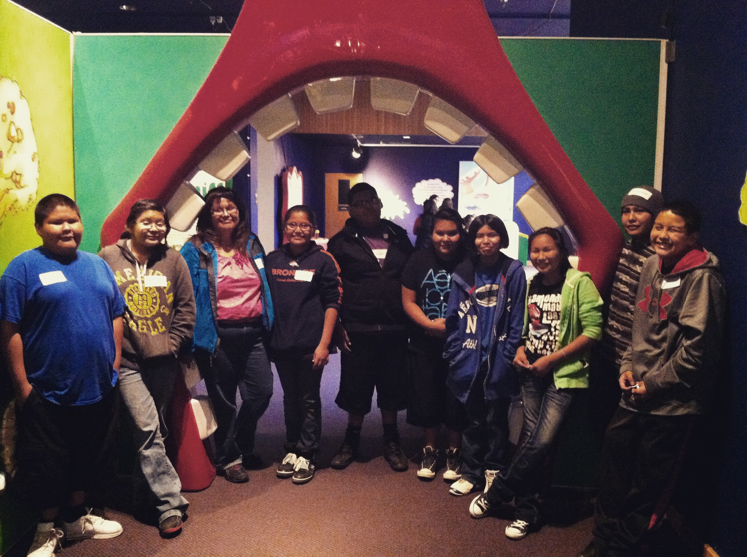 Lybrook students pose outside the Grossology exhibit