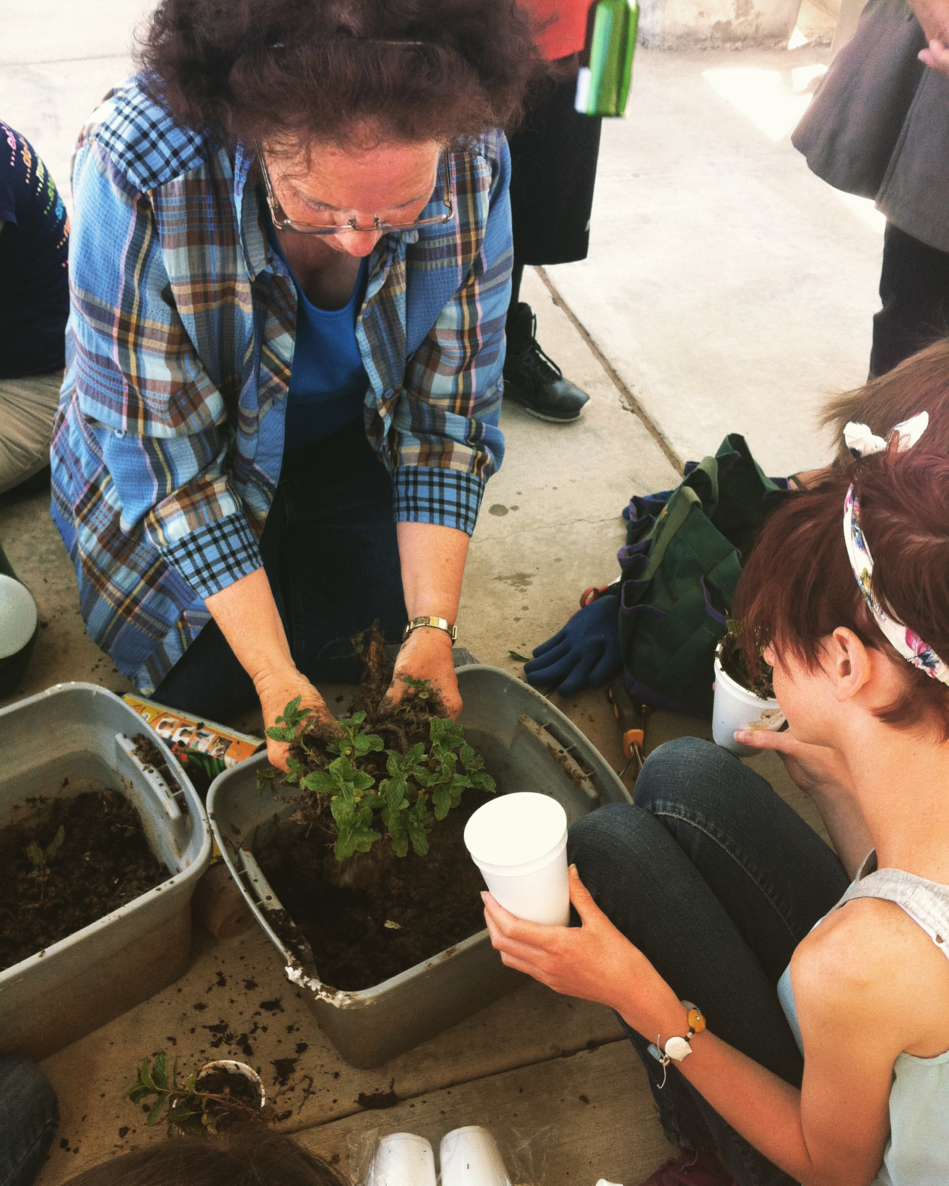 Ms. Mary Lou Gooris teaches students about gardening
