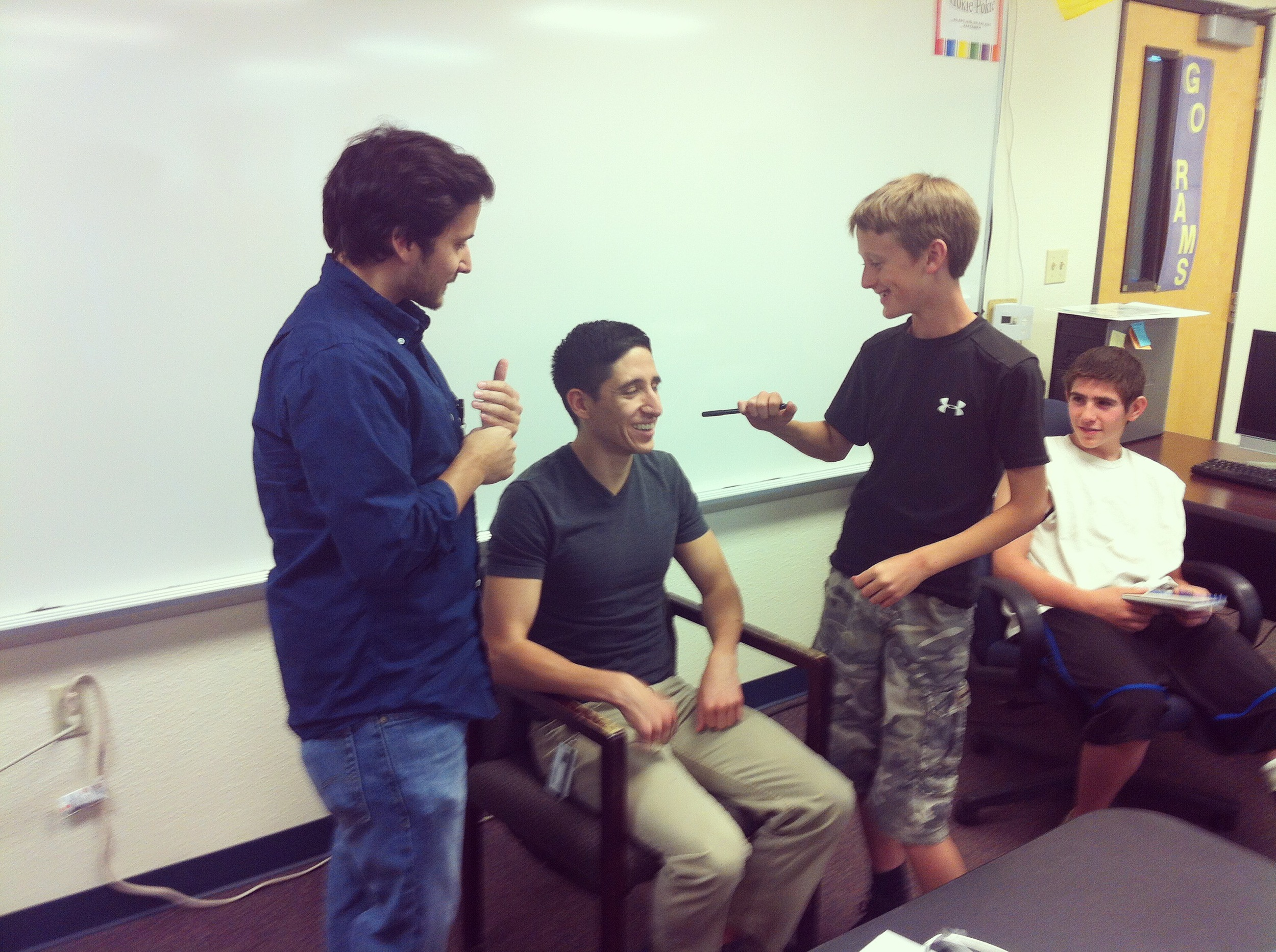 UNM Medical students teach the middle school students how to perform a routine check up