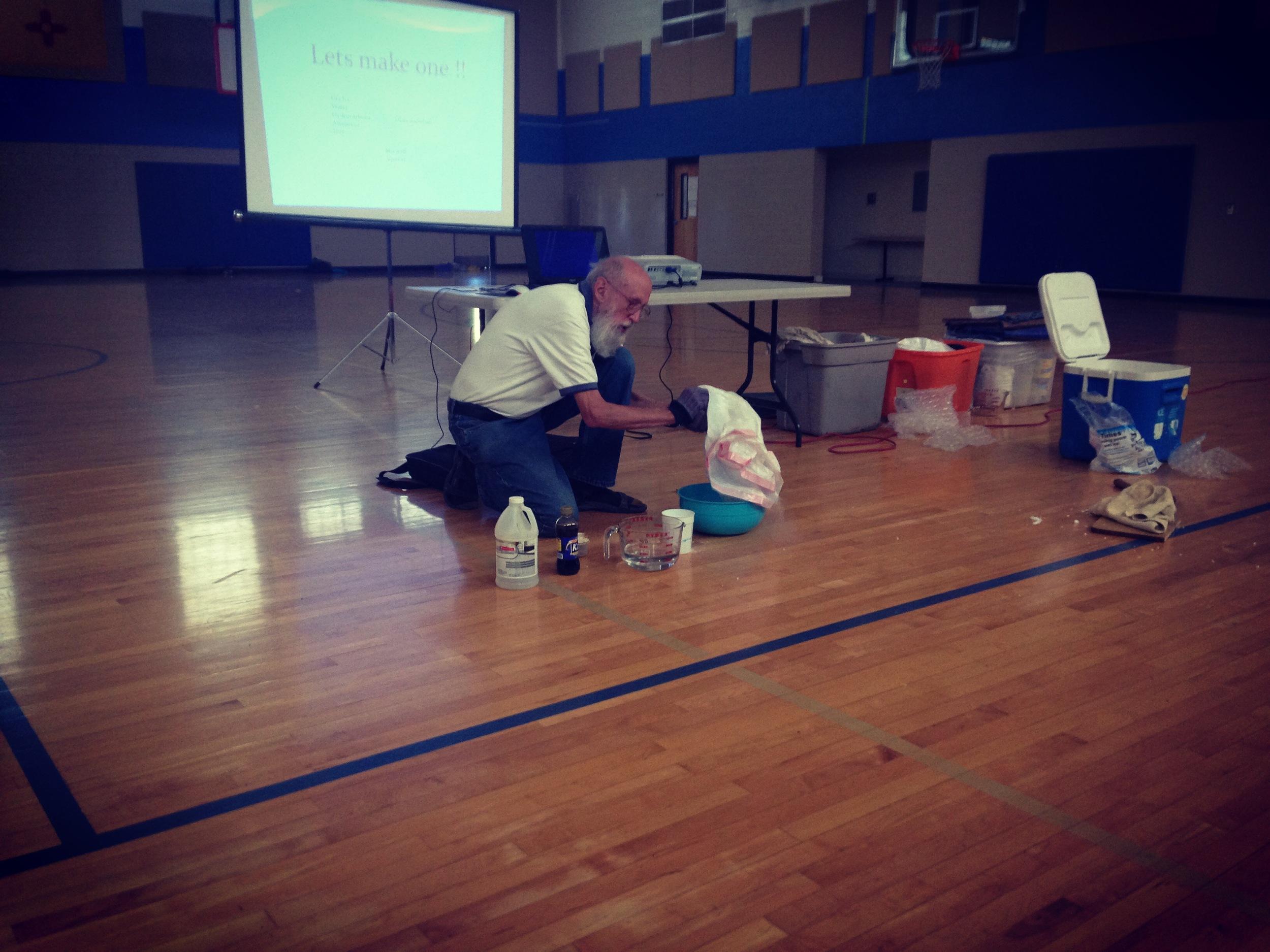 Dr. Dan Klinglesmith makes a commet during assembly