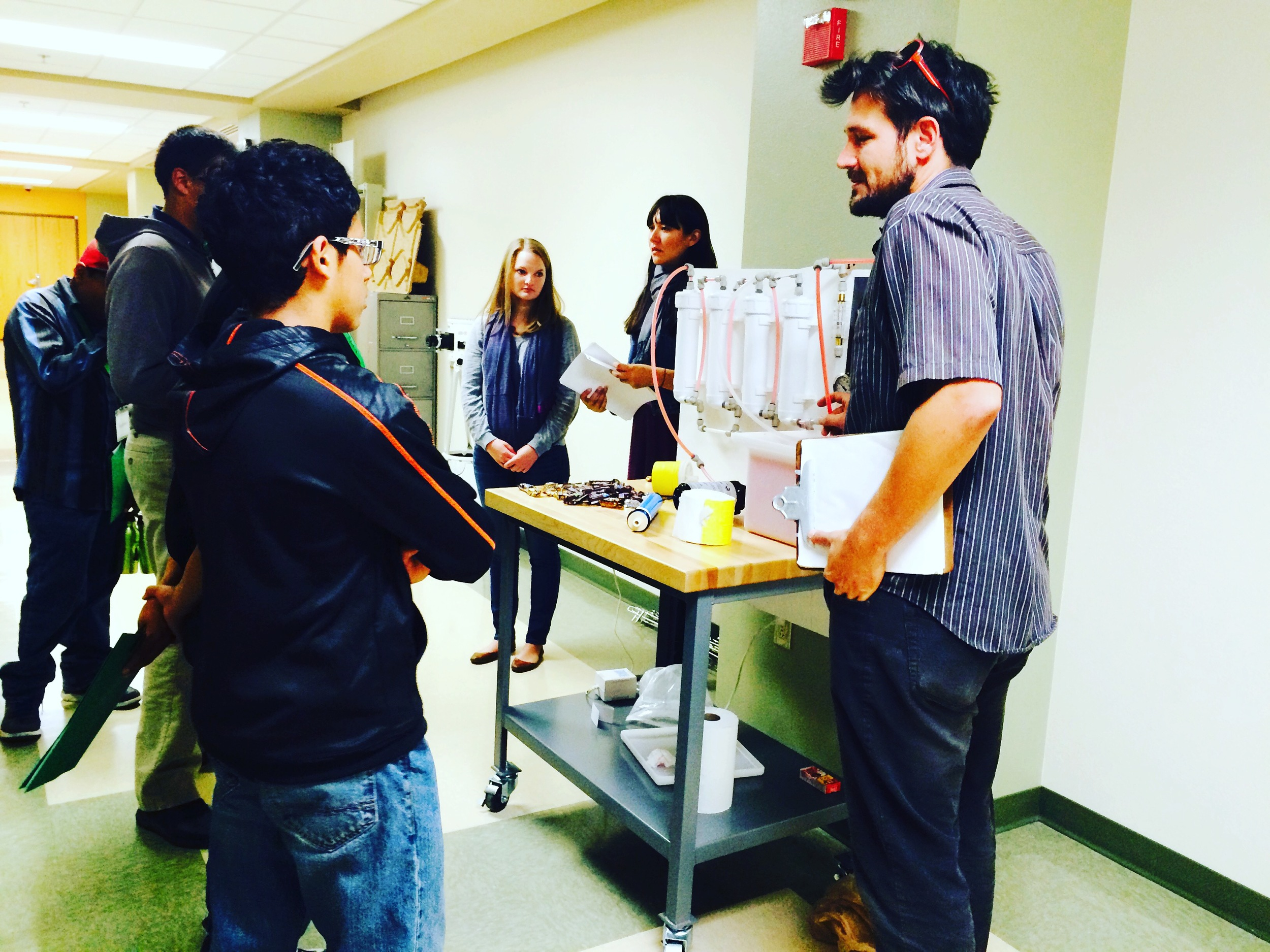 Civil Engineering students show Cuba students a water filtration system