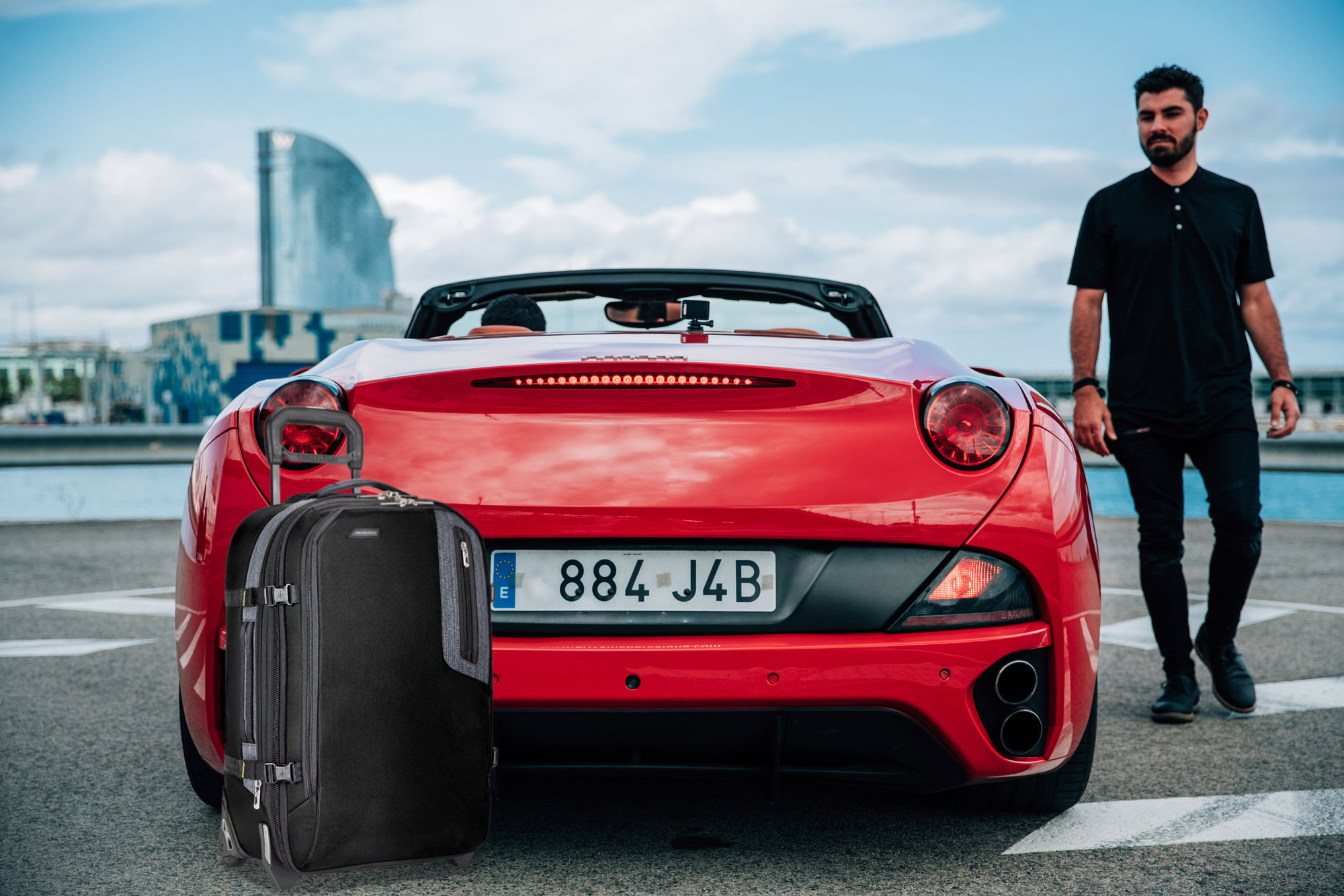 man-beside-euro-sports-car_briggs_riley_brx_luggage.jpg